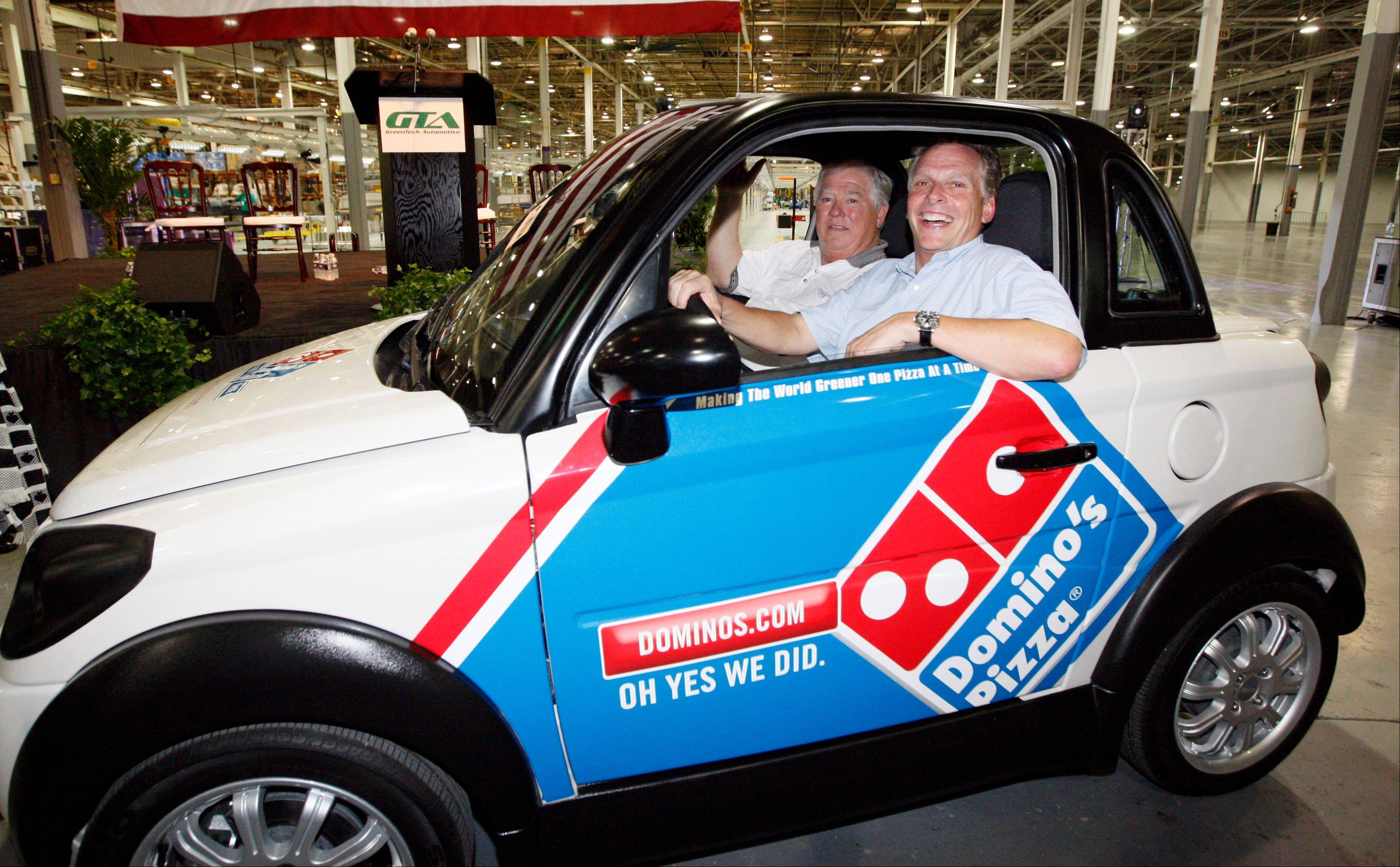 In this July 6, 2012, file photograph, former Mississippi Gov. Haley Barbour, left, and then GreenTech Automotive chairman Terry McAuliffe take a drive through the plant after the unveiling of the company�s new electric MyCar in Horn Lake, Miss. Today, the place where the plant was to be remains mostly vacant except for a temporary construction trailer. The company is under investigation by the Securities and Exchange Commission.