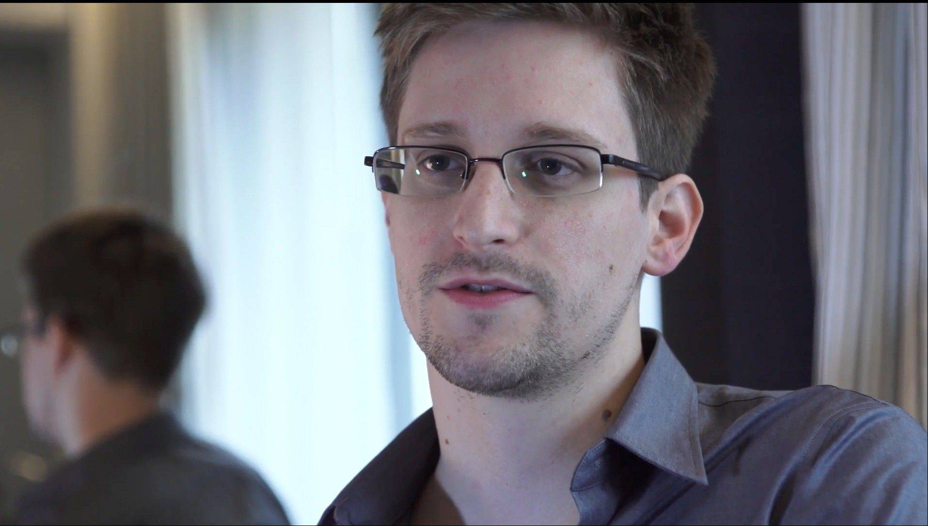 This Sunday, June 9, 2013 file photo provided by The Guardian Newspaper in London shows Edward Snowden, in Hong Kong. US leaker Edward Snowden's father is making plans to travel to Russia to visit his son. Snowden has been granted a document that allows him to leave the transit zone of a Moscow airport and enter Russia. Snowden has applied for temporary asylum in Rusia last week after his attempts to leave the airport were thwarted. The United States wants him sent home to face prosecution for espionage.