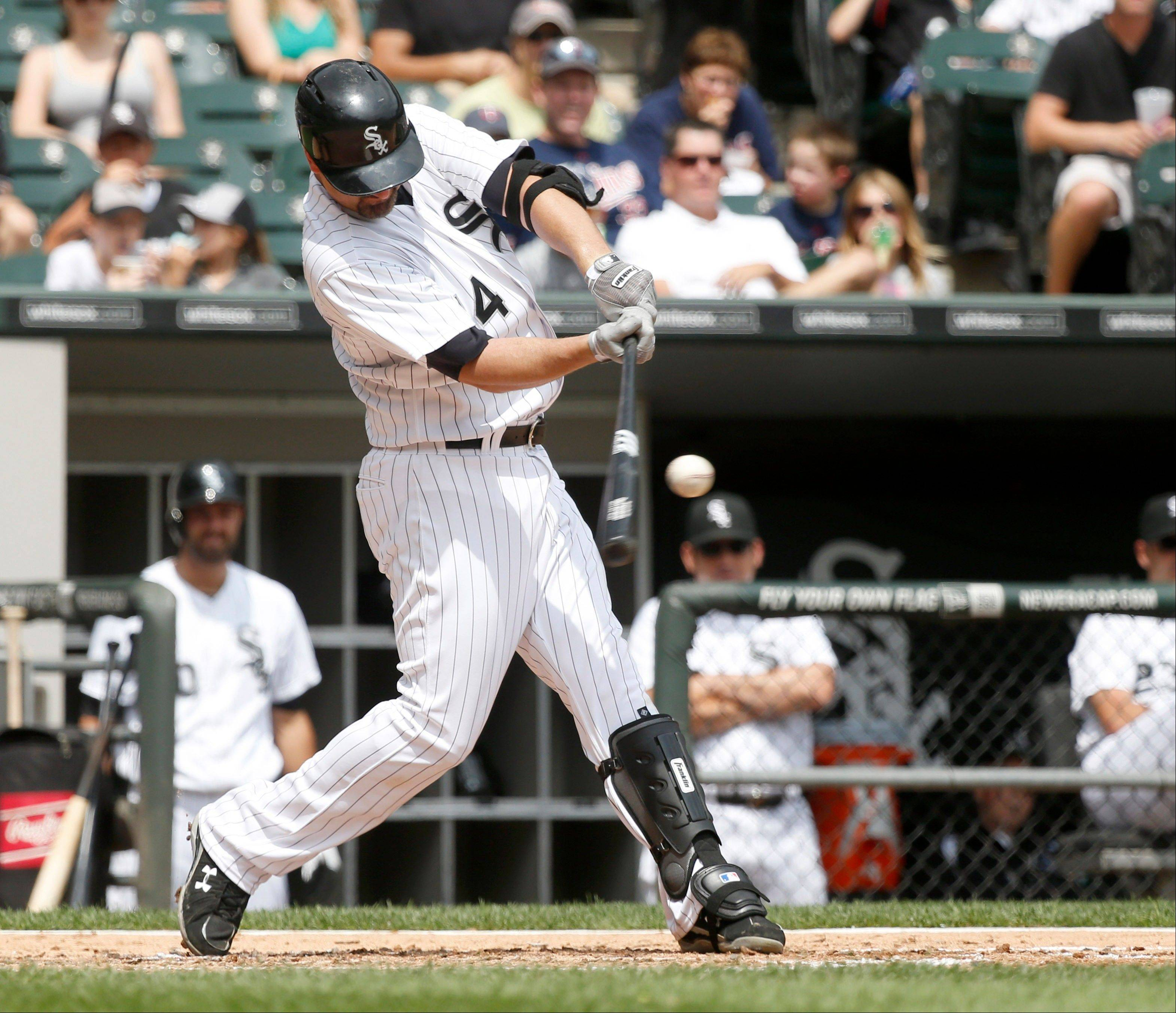 The White Sox� Paul Konerko hits a home run off Minnesota Twins starting pitcher Kyle Gibson during the second inning of a baseball game Friday, Aug. 9, 2013, in Chicago.