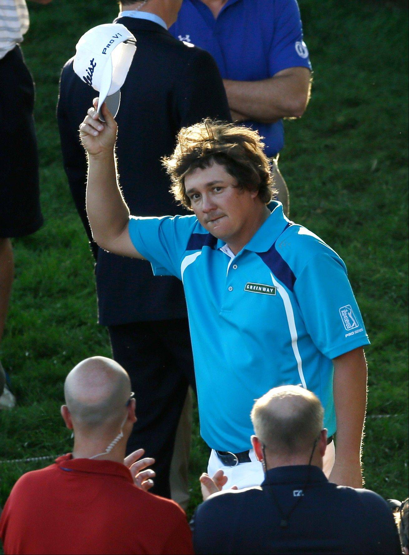 Jason Dufner tips his cap to the crowd after winning his first major, capturing the PGA Championship by 2 strokes over Jim Furyk.