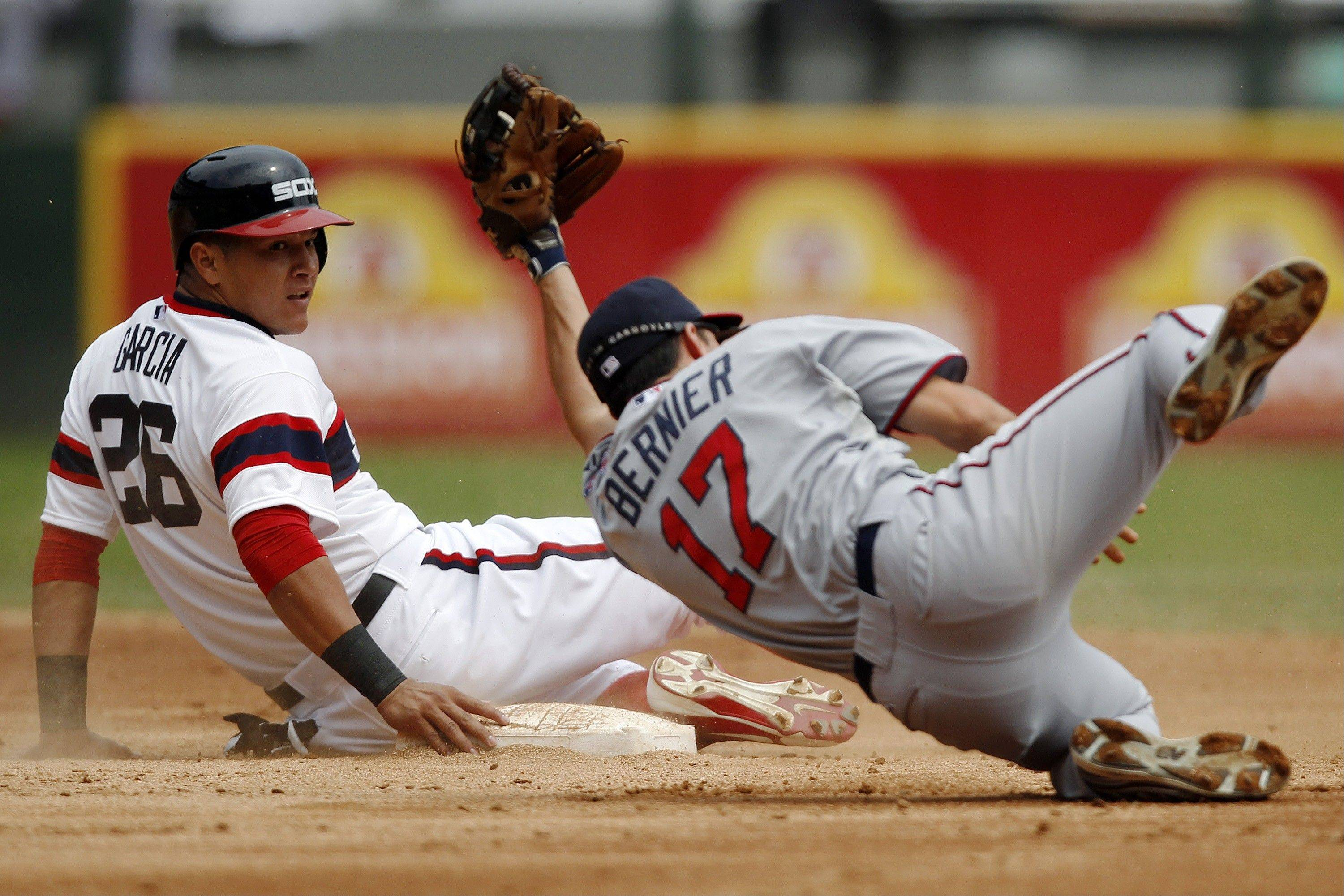 The White Sox' Avisail Garcia, left, steals second as Minnesota Twins shortstop Doug Bernier is late on the tag during Sunday's second inning at U.S. Cellular Field.