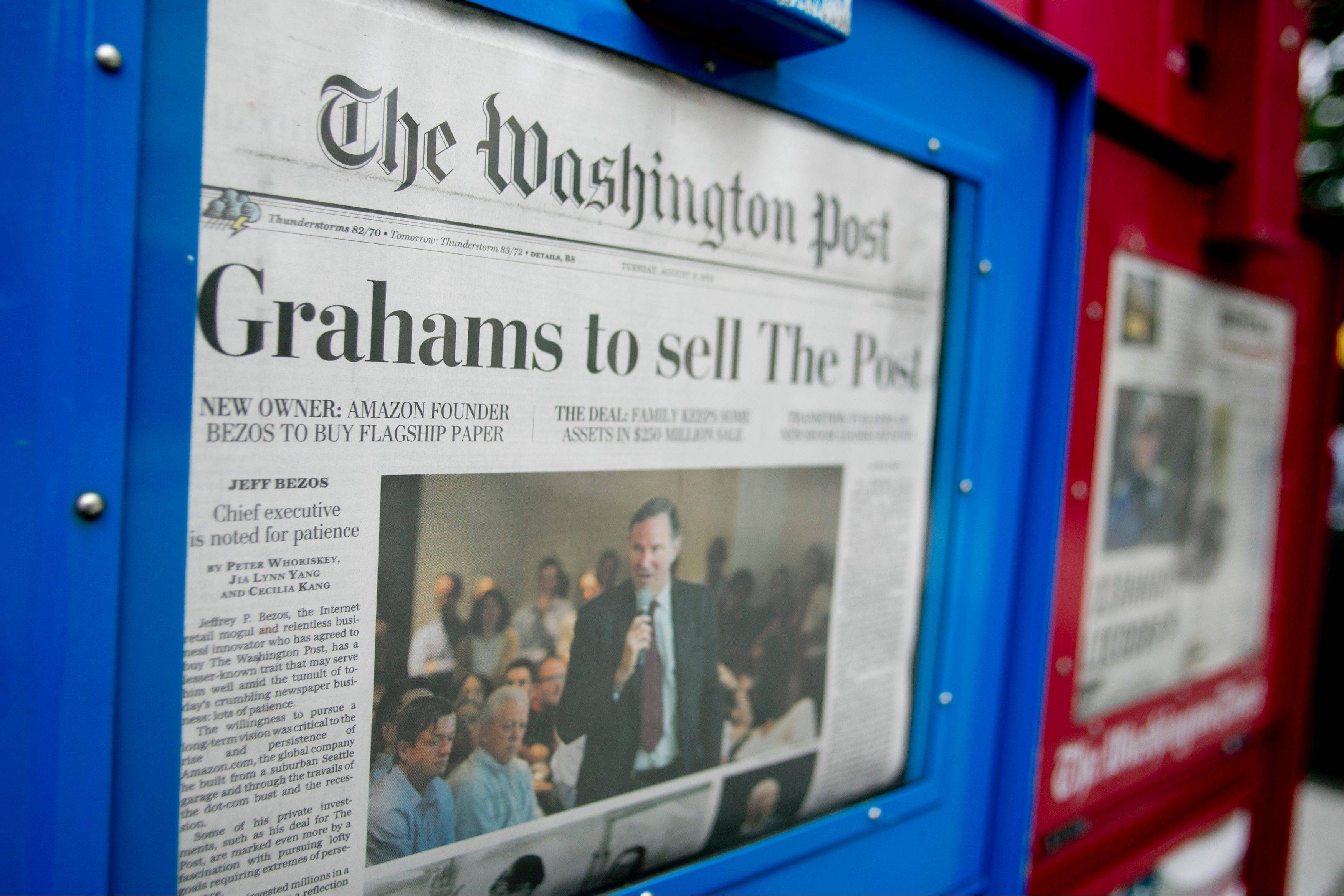 The news that the owners of The Washington Post are to sell the newspaper to billionaire Jeff Bezos is displayed on the front page of the newspaper in Washington, D.C., on Tuesday, Aug. 6, 2013. Amazon.com Inc. Chief Executive Officer Bezos agreed to buy The Washington Post for $250 million, betting that he can apply his success in e-commerce to the struggling newspaper industry.