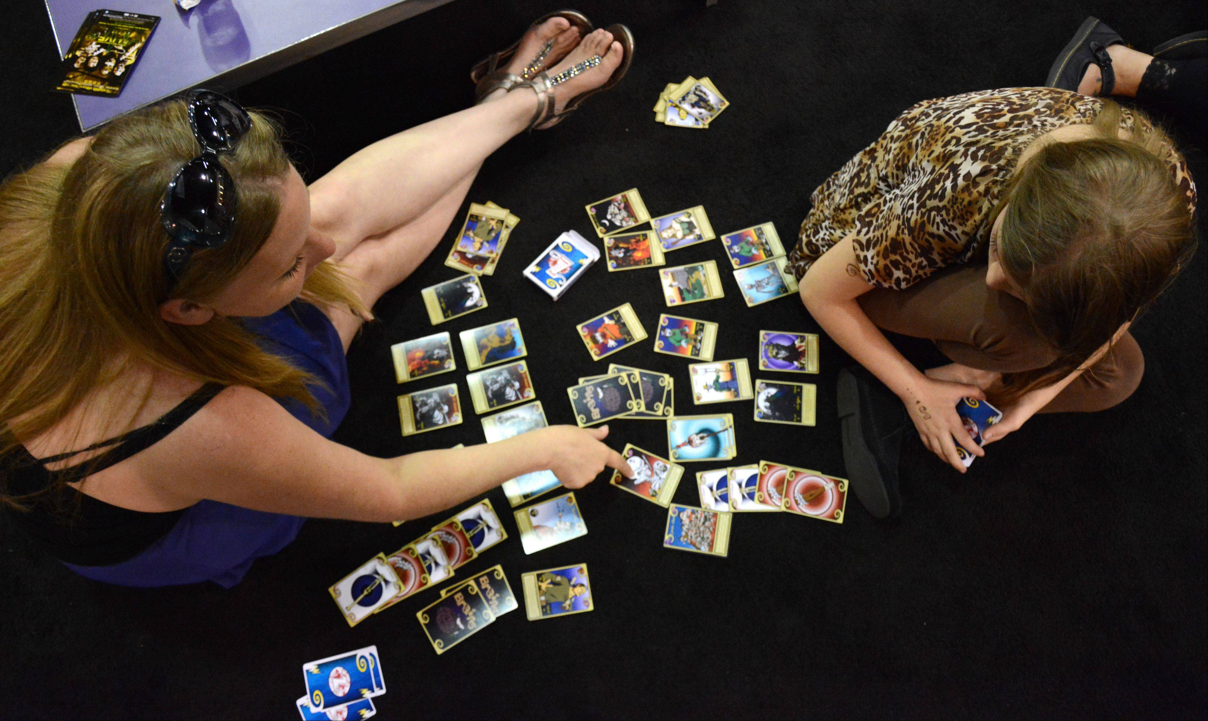Christi Blais, left, of Rockford, and daughter Justice Sweeney, 10, play a game of Zombits during Wizard World Chicago Comic Con in Rosemont Sunday.