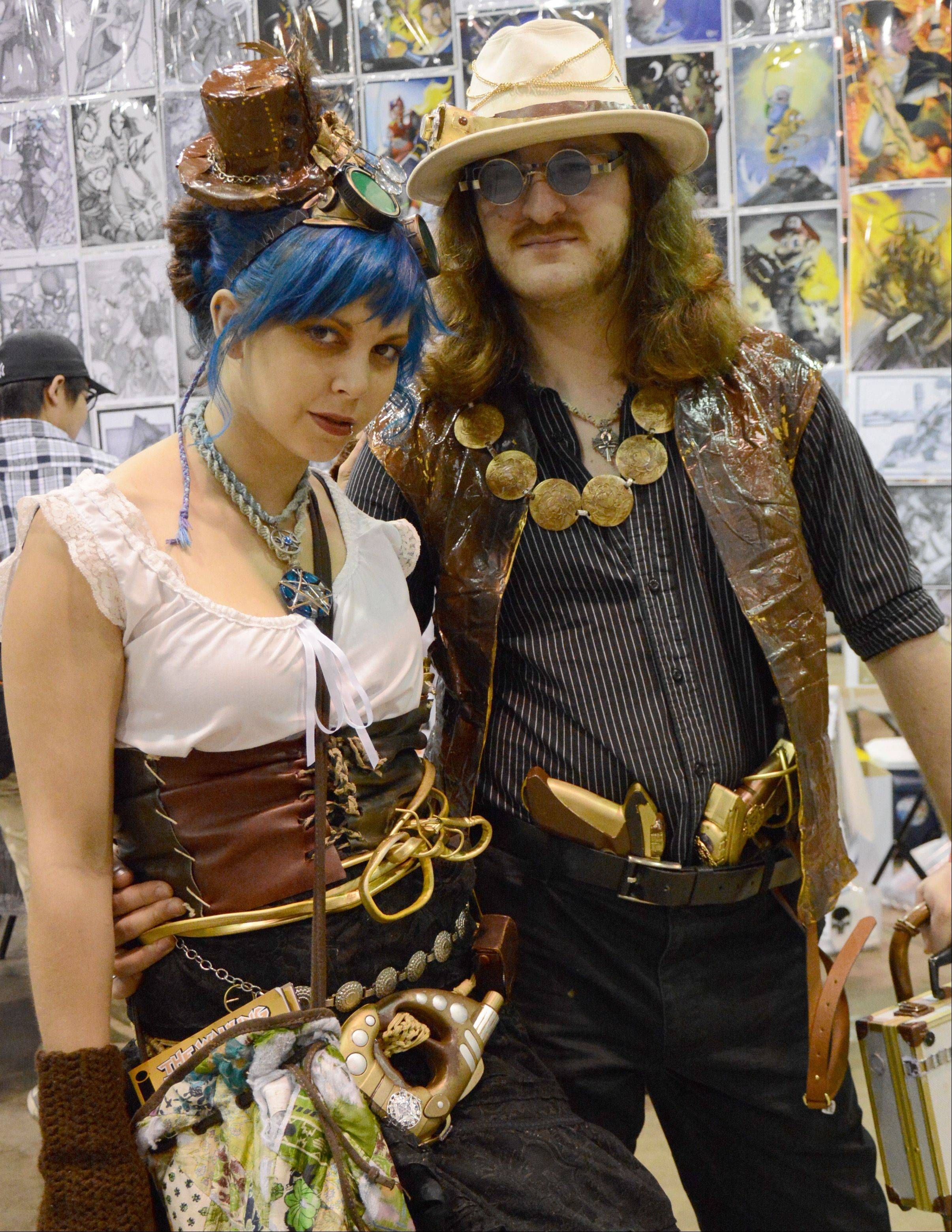Cat Lasee, left, and Nathan Willard, both of Lodi, Wis., dress in Steampunk attire during Wizard World Chicago Comic Con in Rosemont Sunday.