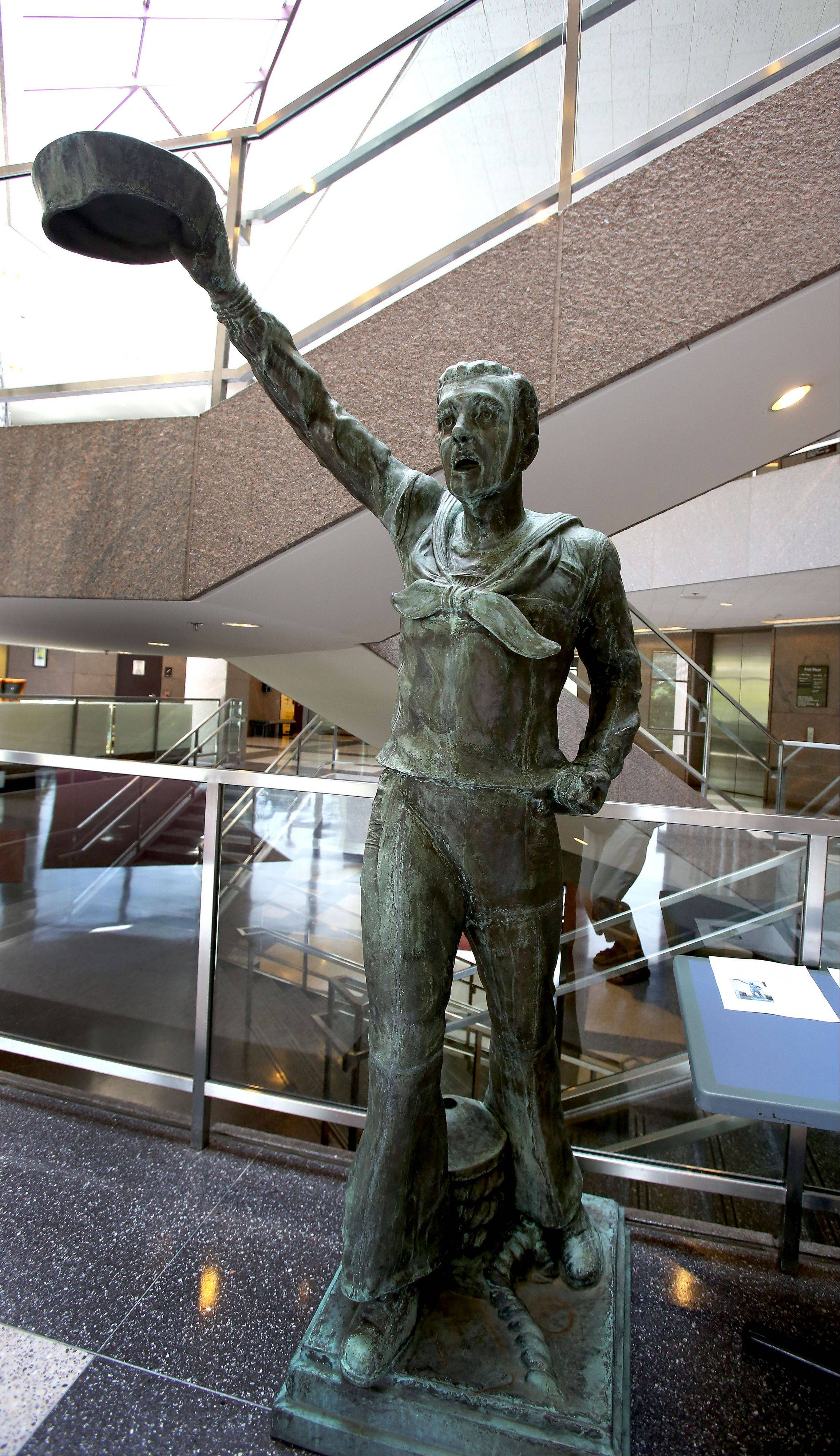 "Naperville's Century Walk Corp. is turning to the crowdfunding website, Citizinvestor, to help raise the last $27,000 it needs to install this 1920s-era sculpture of a sailor called ""Spirit of the American Navy"" by Oct. 13 in Burlington Square Park."