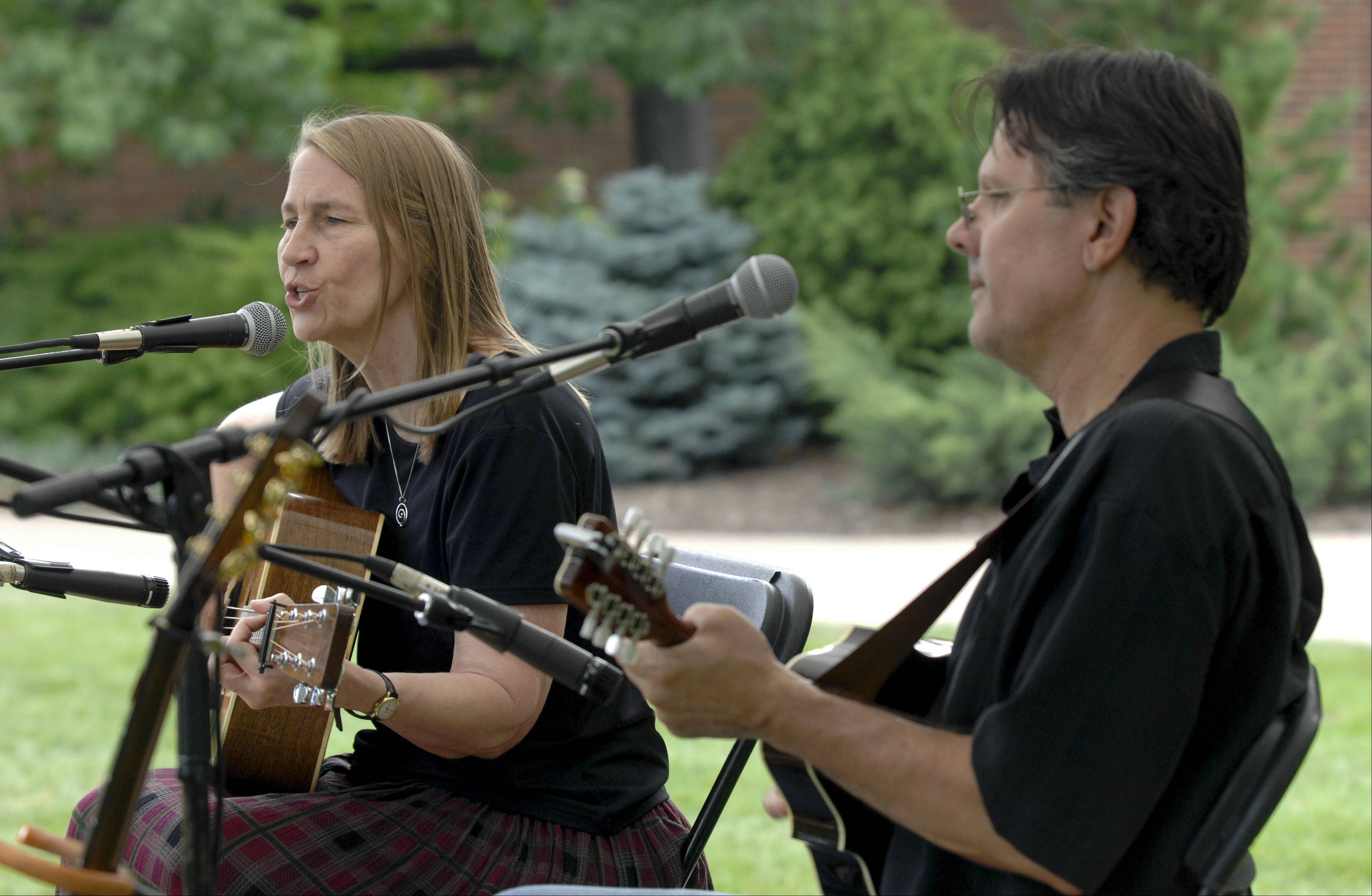 Denise Wilson and Michael Lewis of Traveler's Dream perform at Cantigny Park's French Connection Day Sunday in Wheaton.