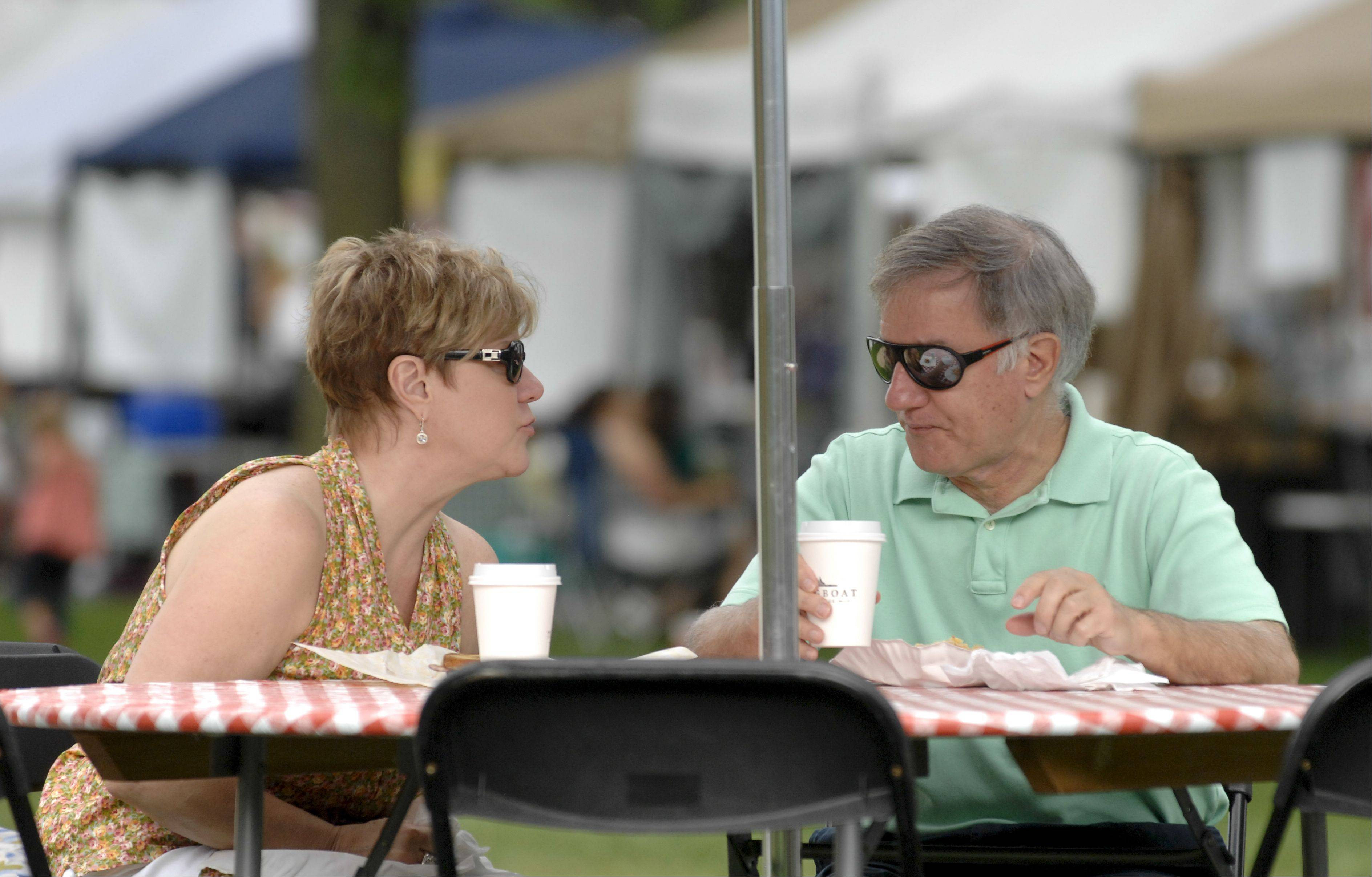 Sandy and Bob Warzin, of Wheaton, enjoy some of the food during French Connection Day at Cantigny Park in Wheaton Sunday.