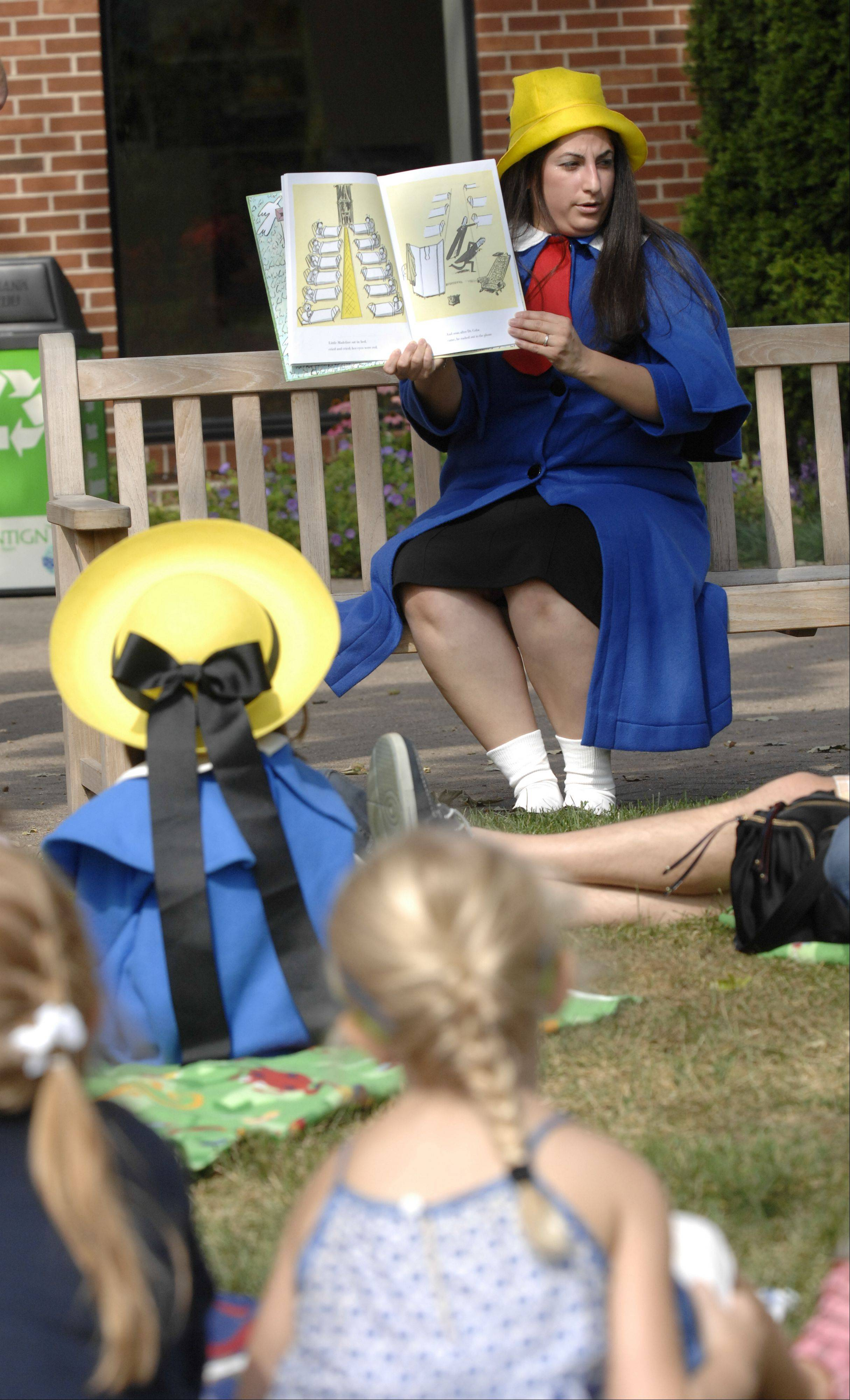 "Edith Roman, of West Chicago, reads ""Madeline"" stories during French Connection Day at Cantigny Park in Wheaton Sunday."