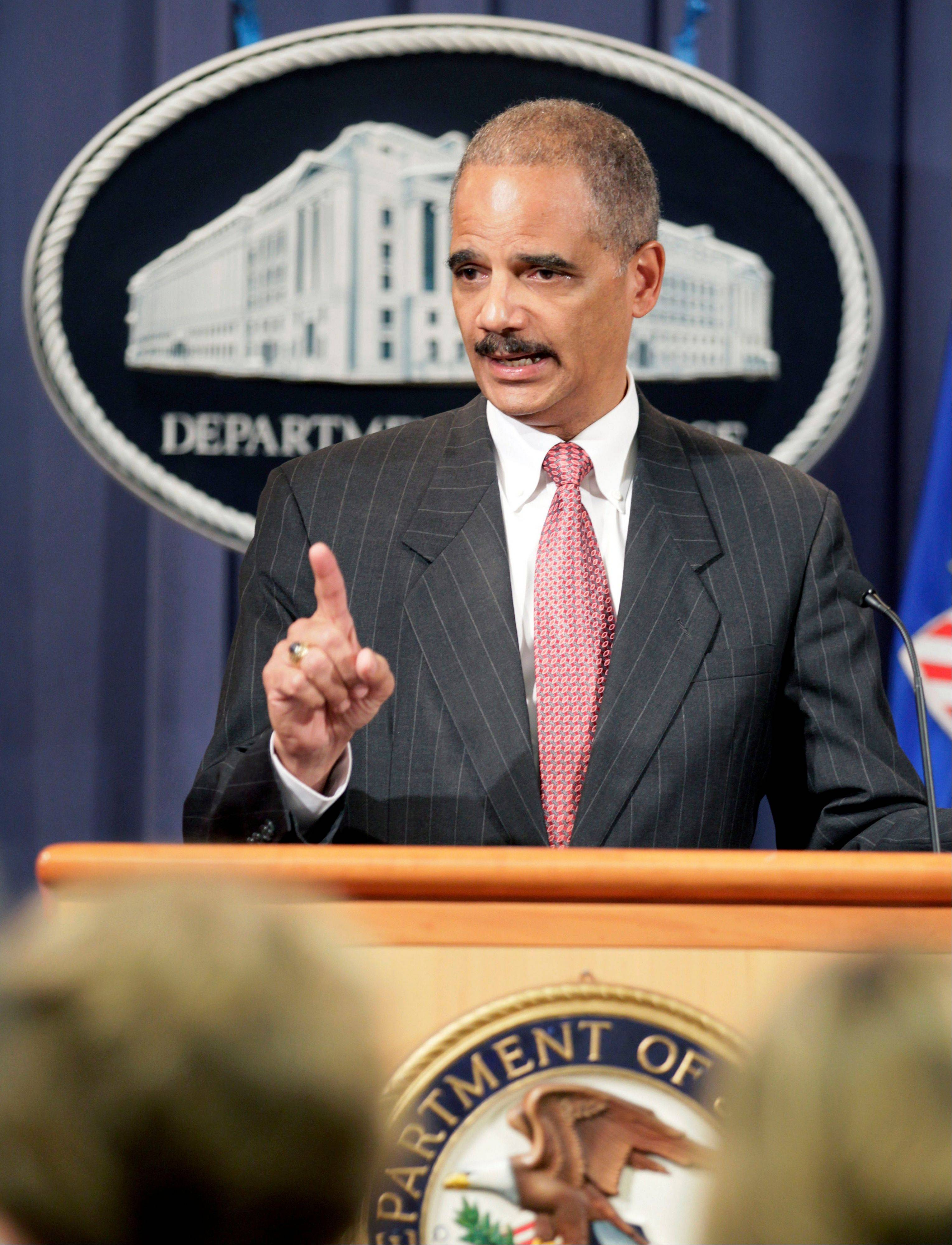 This Oct. 4, 2010 file photo shows Attorney General Eric Holder speaking during a news conference at the Justice Department in Washington. Holder is calling for major changes to the nation's criminal justice system that would scale back the use of harsh prison sentences for certain drug-related crimes, divert people convicted of low-level offenses to drug treatment and community service programs and expand a prison program to allow for release of some elderly, non-violent offenders.
