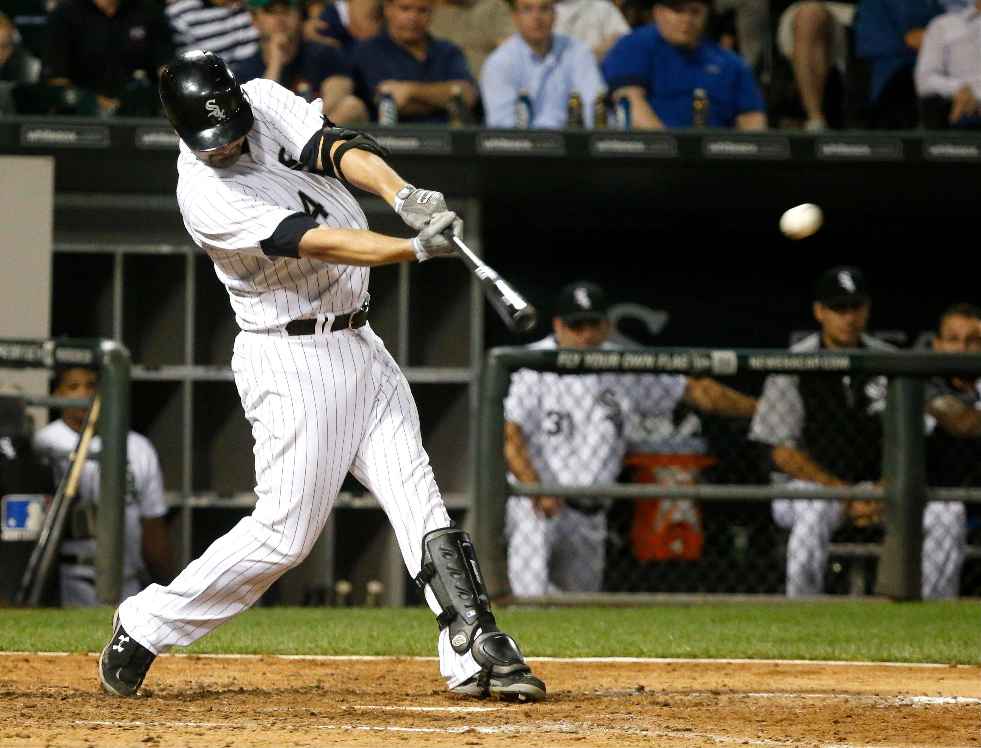 The White Sox' Paul Konerko hits an RBI-double off New York Yankees starting pitcher CC Sabathia during the seventh inning of a baseball game on Wednesday, Aug. 7, 2013, in Chicago.