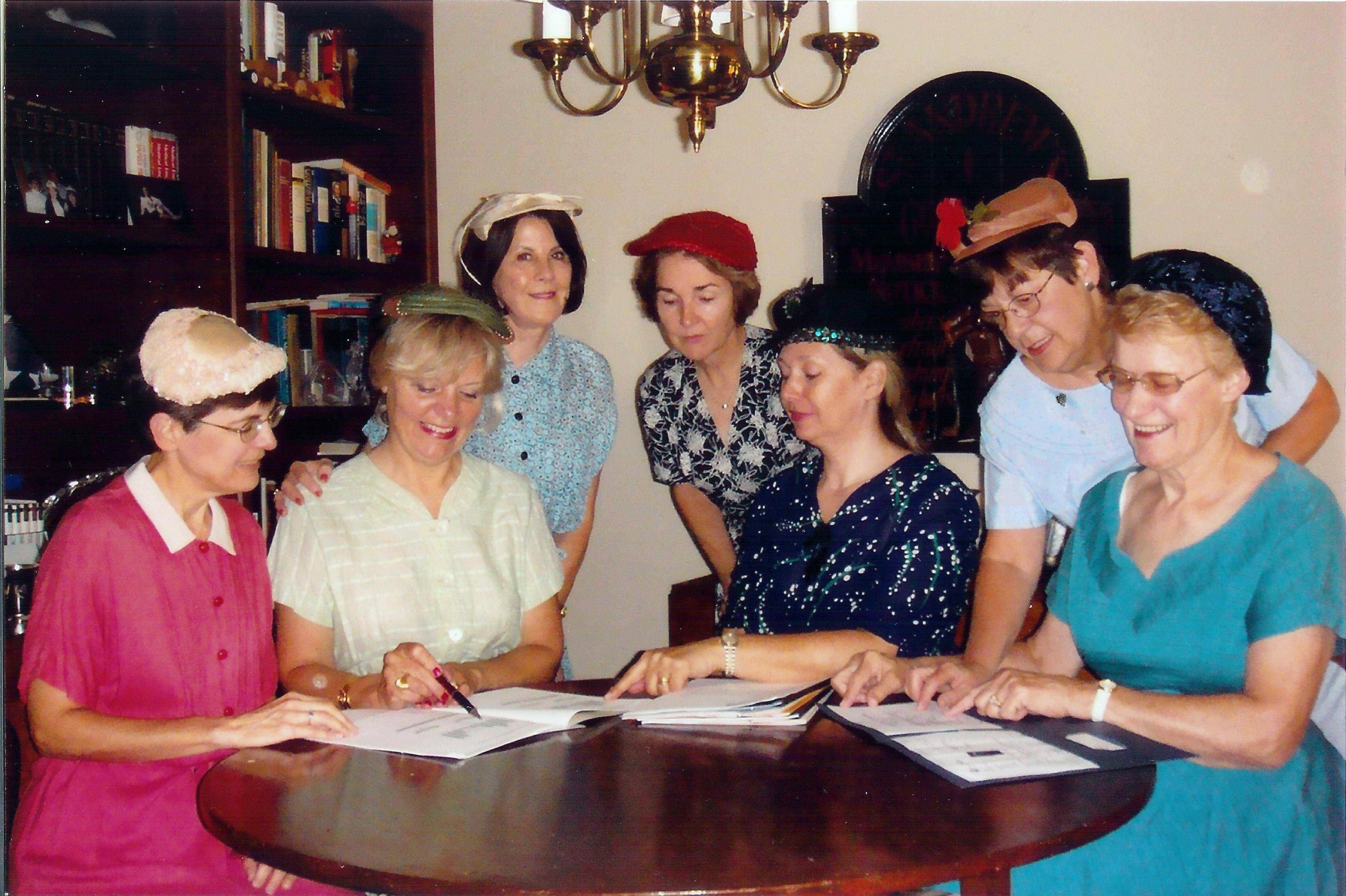 Committee members Linda Osikowicz, Sherrie Anuskewicz, Pam Larsen, Mary Mellon, Nancy Koutsis, Carolyn Schneider, and Norma Jung-Stein pay are dressed to match the historical period of the early years of the Barrington United Methodist Church Rummage Sale.  Not pictured:  Sandy Starnes and Mary Williams.
