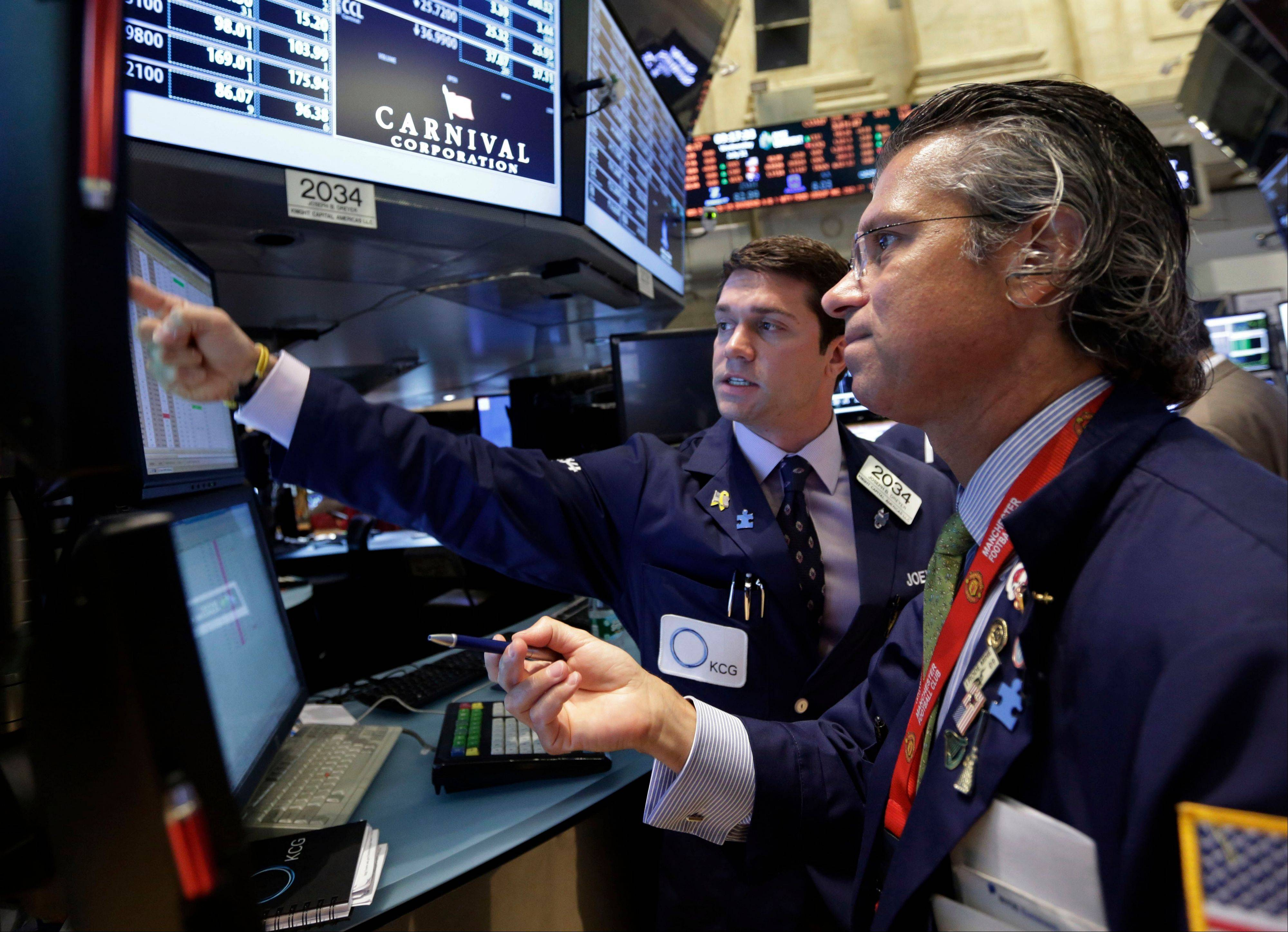 In this Wednesday, July 31, 2013 file photo, specialists Joseph Dreyer, left, and Donald Civitanova work on the floor of the New York Stock Exchange. After a losing week for the three major stock indexes, investors are hoping for a rebound on Wall Street, Monday, Aug. 12, 2013.