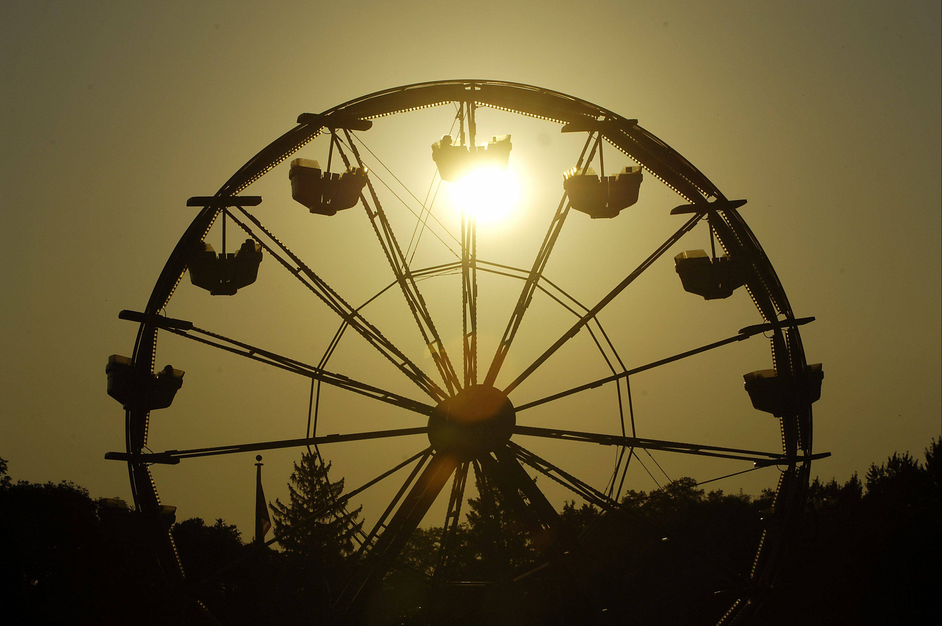 The sun sets on the opening night of South Elgin�s RiverFest Express. This year, the festival runs Thursday, Aug. 15, through Sunday, Aug. 18, at Panton Mill Park.
