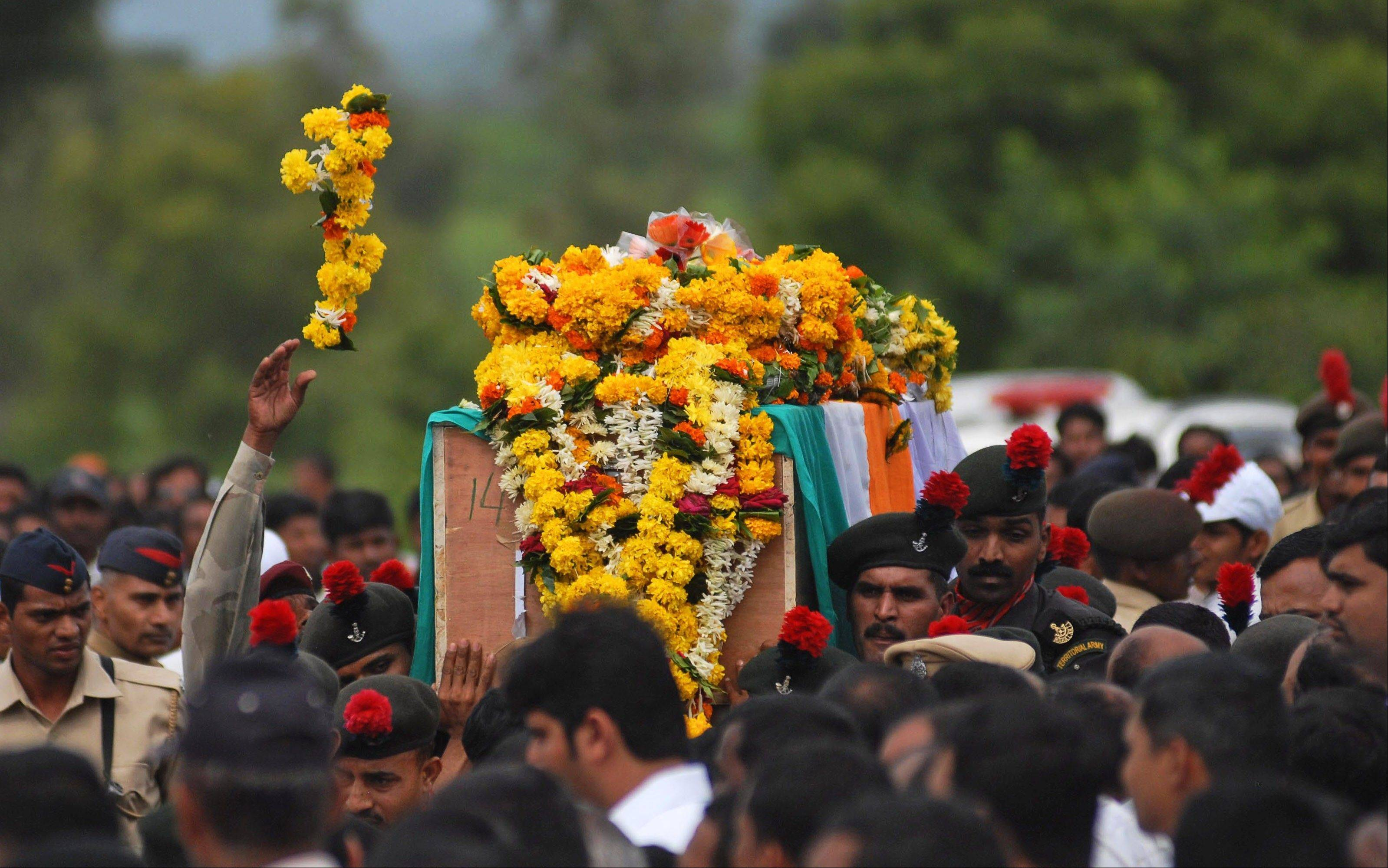 Indian army soldiers carry the coffin of their colleague Naik Kundalik Mane, allegedly killed by Pakistani soldiers Tuesday, during his funeral procession at Pimpalgaon village, in the western Indian state of Maharashtra, Thursday, Aug. 8, 2013. India has directly accused Pakistani army troops of killing five Indian soldiers in the disputed Himalayan region of Kashmir and implied this could hit peace efforts by the two countries. Pakistan accused Indian troops of shelling its territory along the disputed Kashmir border on Monday and killing a civilian, the latest in a series of allegations of cross-border attacks made by both sides over the past week.