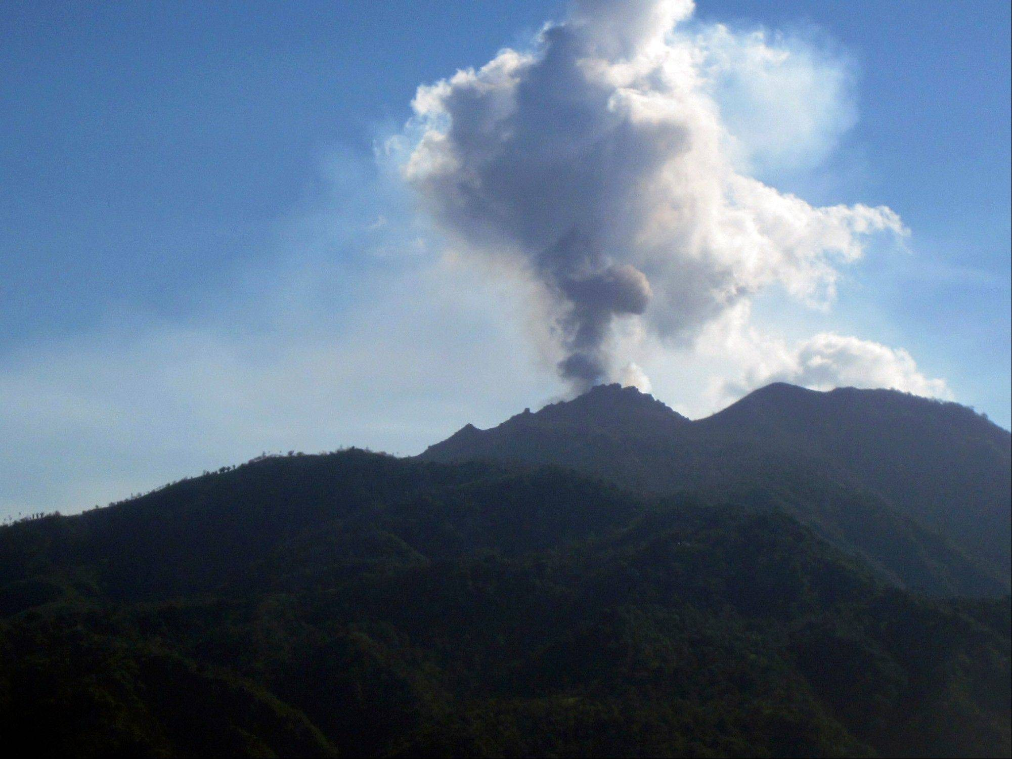 Mount Rokatenda spews volcanic smoke on Palue island, Indonesia, Monday. The volcano spewed more hot ash and lava on the tiny Indonesian island Monday after causing six deaths during its eruption over the weekend.