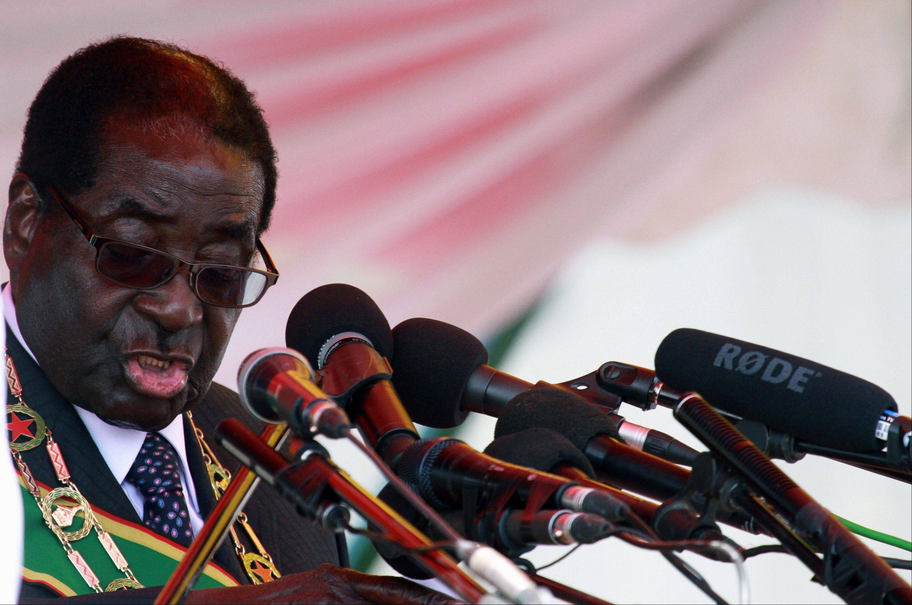 Zimbabwean President-elect Robert Mugabe reads his speech during the country�s commemoration of Heroes� Day in Harare, Monday. Zimbabwe�s longtime president says his party will not yield its victory in elections that although disputed were endorsed by African observers and conducted without the violence that marred previous polls.