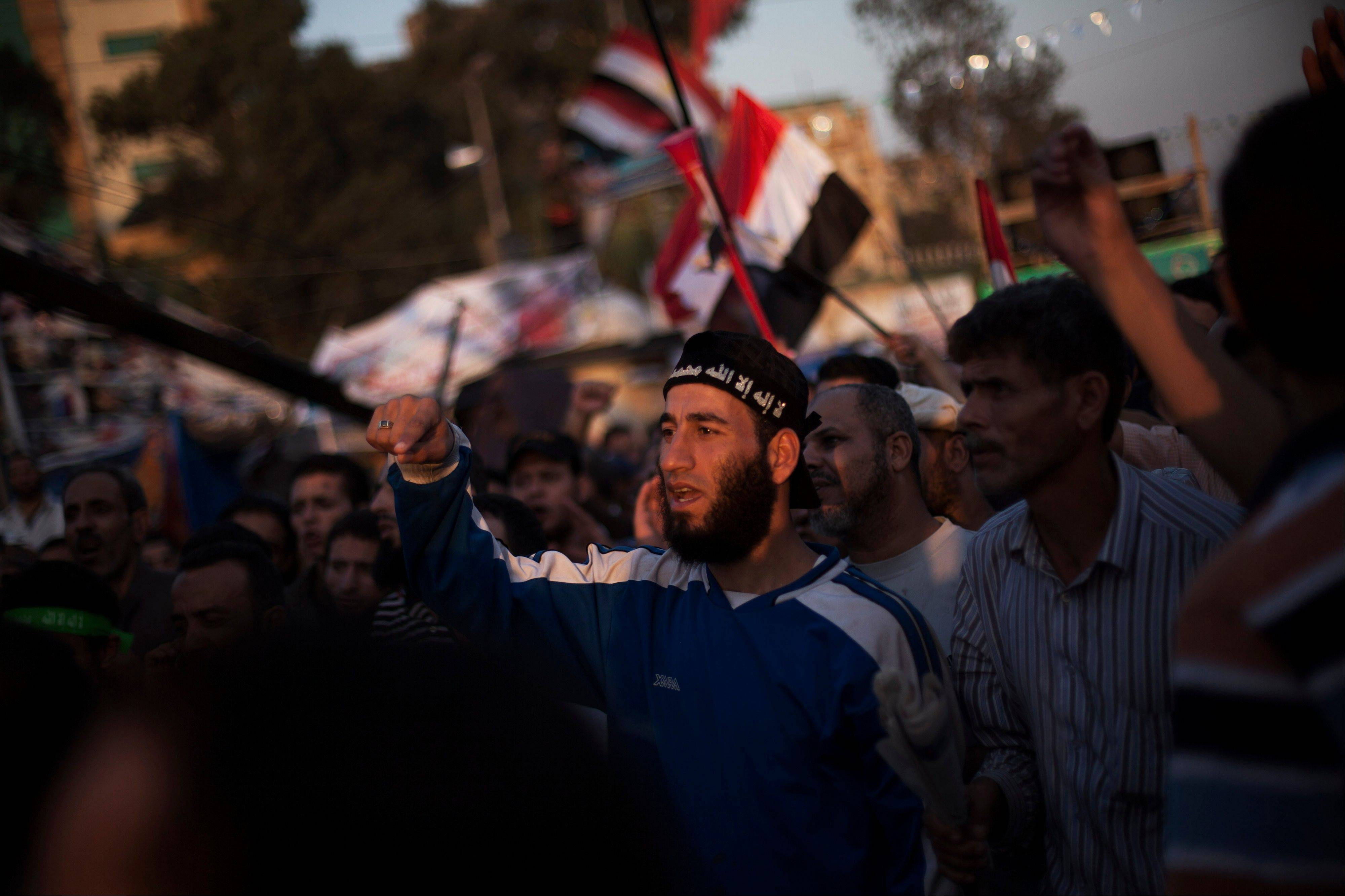 Supporters of Egypt�s ousted President Mohammed Morsi chant slogans during their sit-in around Rabaa Al-Adawiya mosque, which is fortified with multiple walls of bricks, tires, metal barricades and sandbags, where protesters have installed their camp in Nasser City, Cairo, Egypt, on Monday.