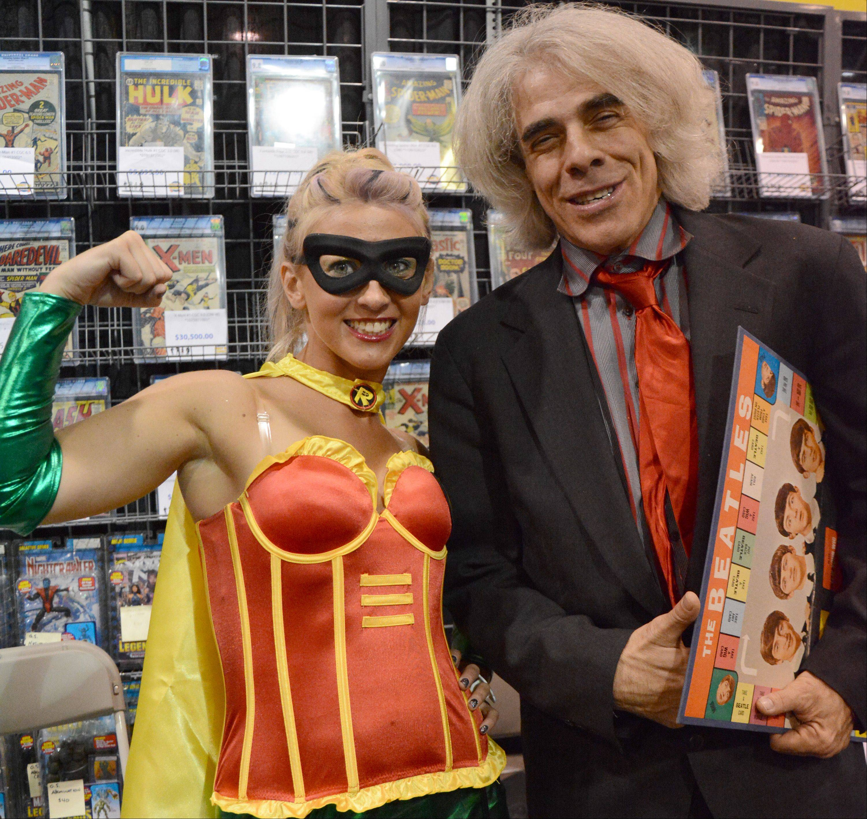From left, Alicia Ziller, of Highland, Ind., and Mike Carbondaro, of Tonawanda, N.Y., pose for a photo Sunday at Wizard World Chicago in Rosemont.