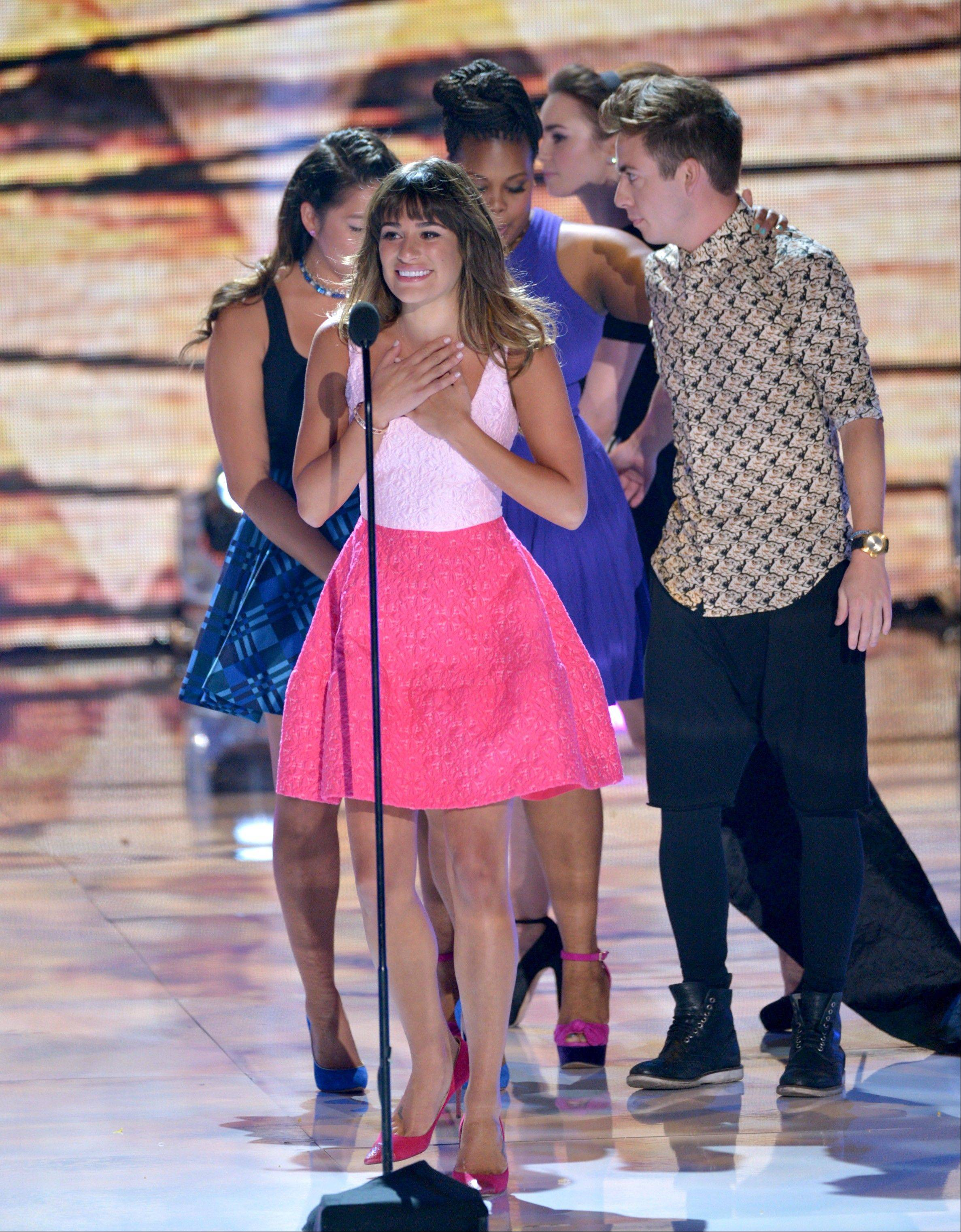 Lea Michele speaks on stage at the Teen Choice Awards at the Gibson Amphitheater on Sunday in Los Angeles. Pictured in background from left, are her �Glee� co-stars Jenna Ushkowitz, Amber Riley and Kevin McHale.