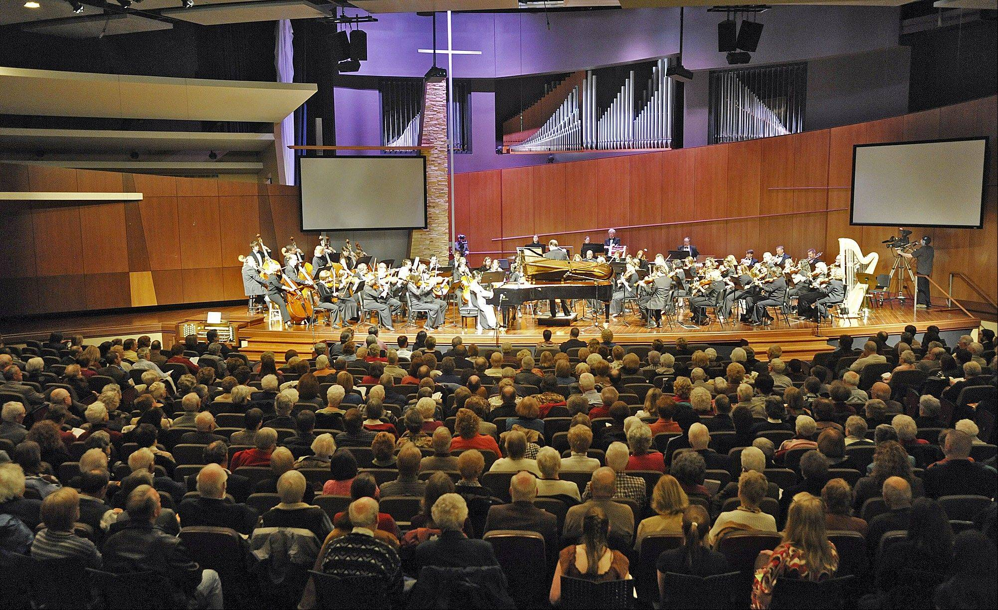 The Elmhurst Symphony Orchestra has a total budget of about $270,000, including about $22,000 from a community grant from the city of Elmhurst. The orchestra is pictured in a past performance at The Elmhurst Christian Reformed Church.