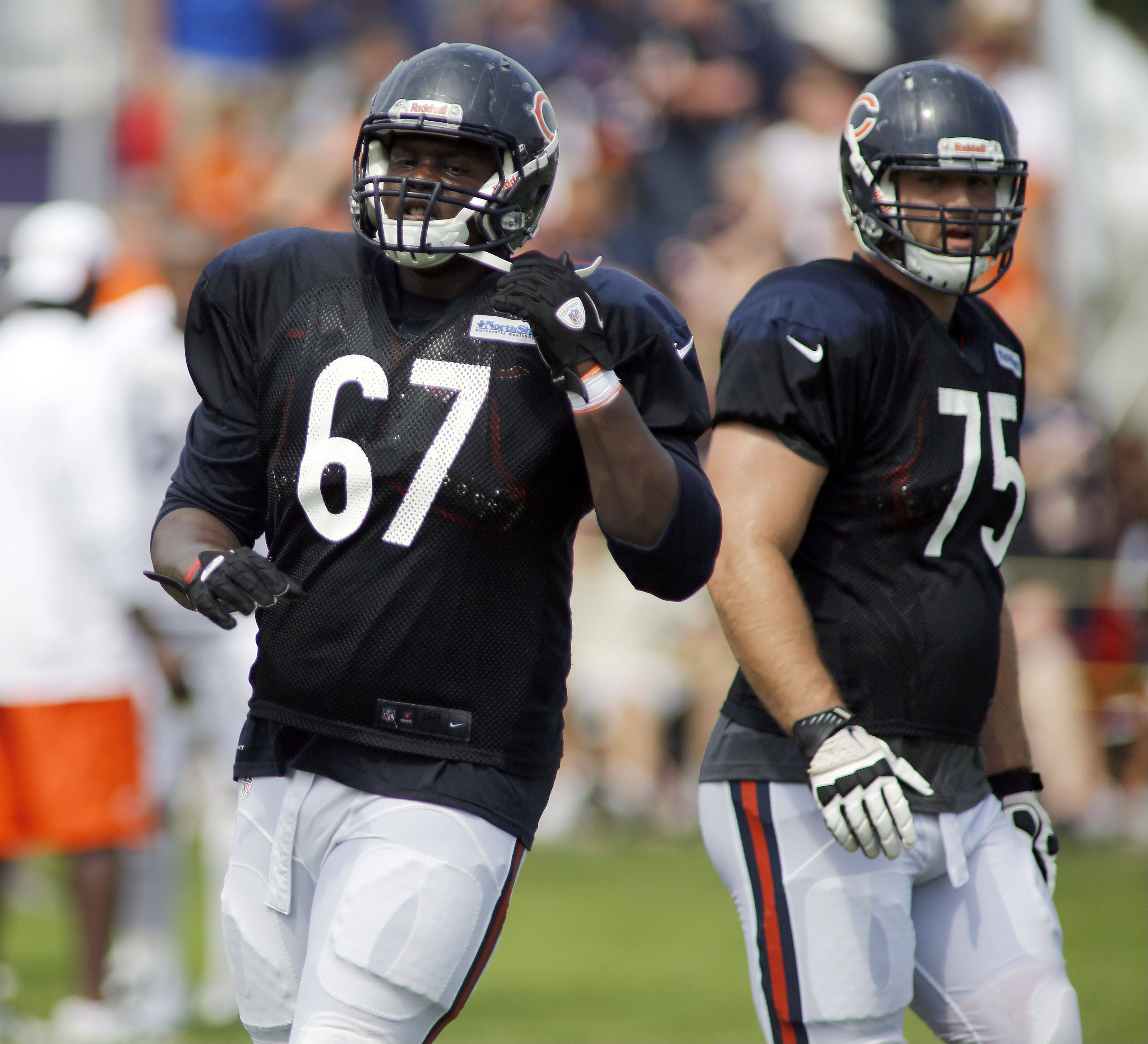 Offensive linemen Jordan Mills (67) and Kyle Long earned the praise of Bears coach Marc Trestman for their performance in practice Monday.