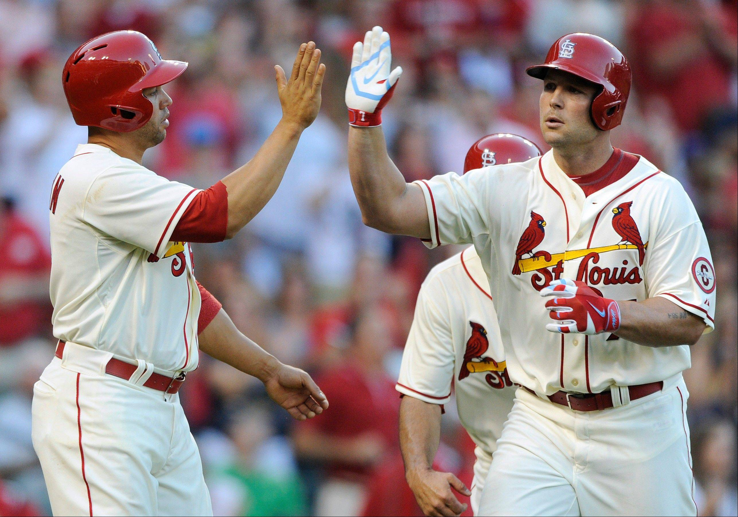 St. Louis Cardinals' Matt Holliday, right, is congratulated by Carlos Beltran, after his 3-run home run against the Cubs in the fourth inning Saturday.