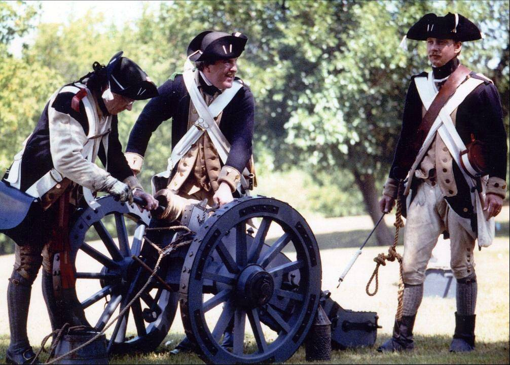 David Nordin, right, and friends get ready to fire a Revolutionary War howitzer.