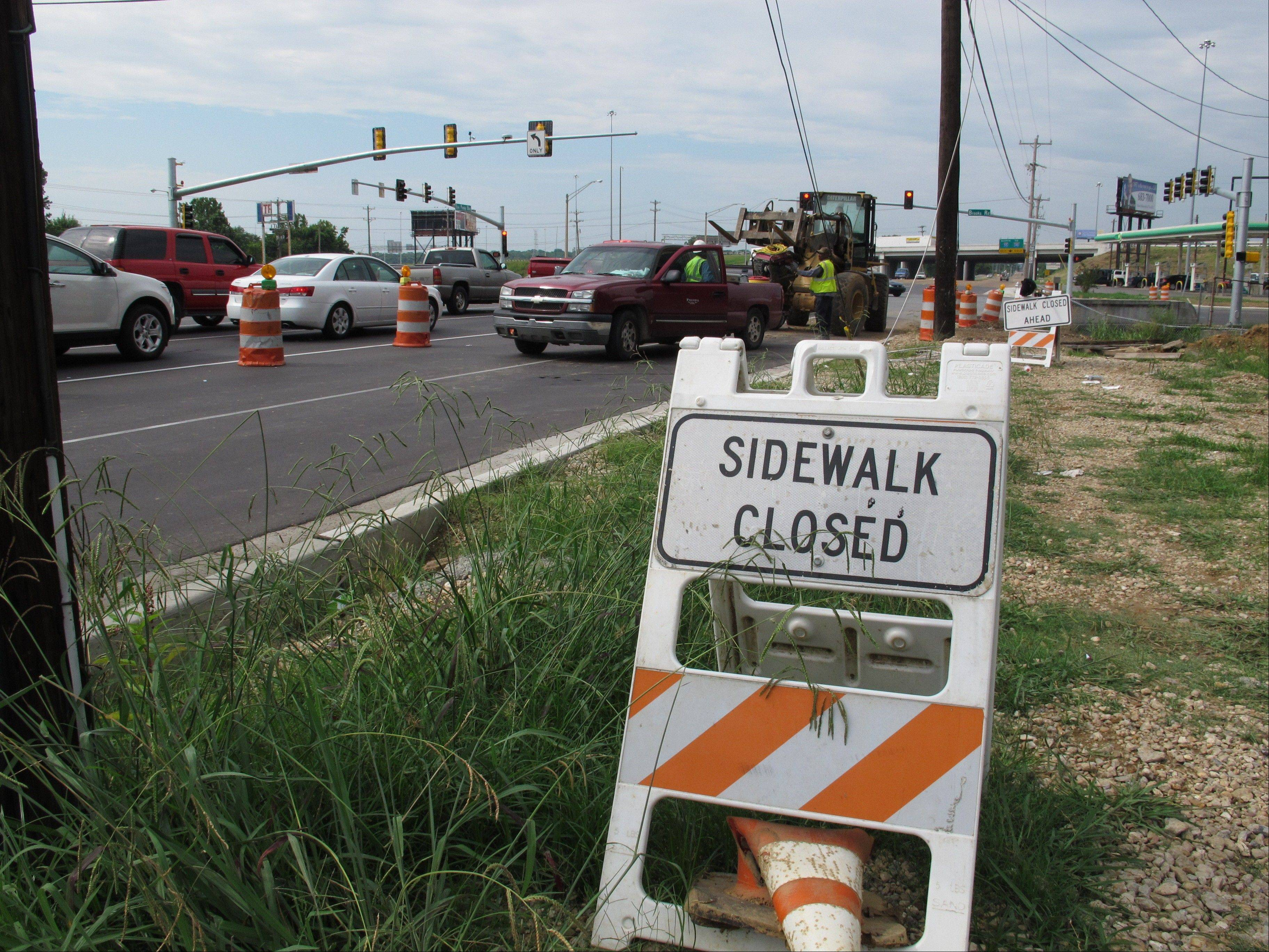 "A ""sidewalk closed"" sign marks the spot where workers are making improvements to Elvis Presley Boulevard in Memphis."