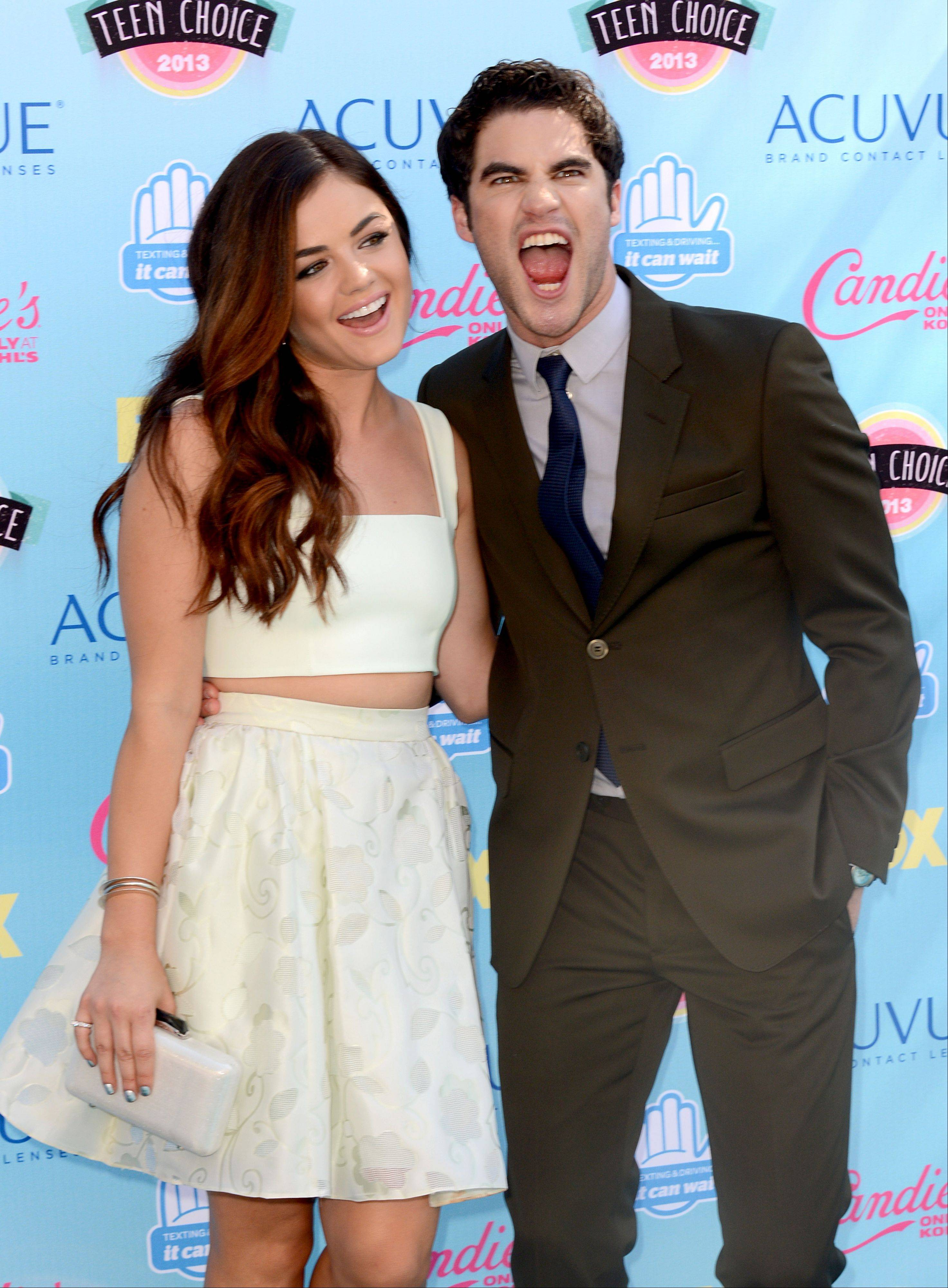 Lucy Hale, left, and Darren Criss have a little fun along the press line at the Teen Choice Awards.