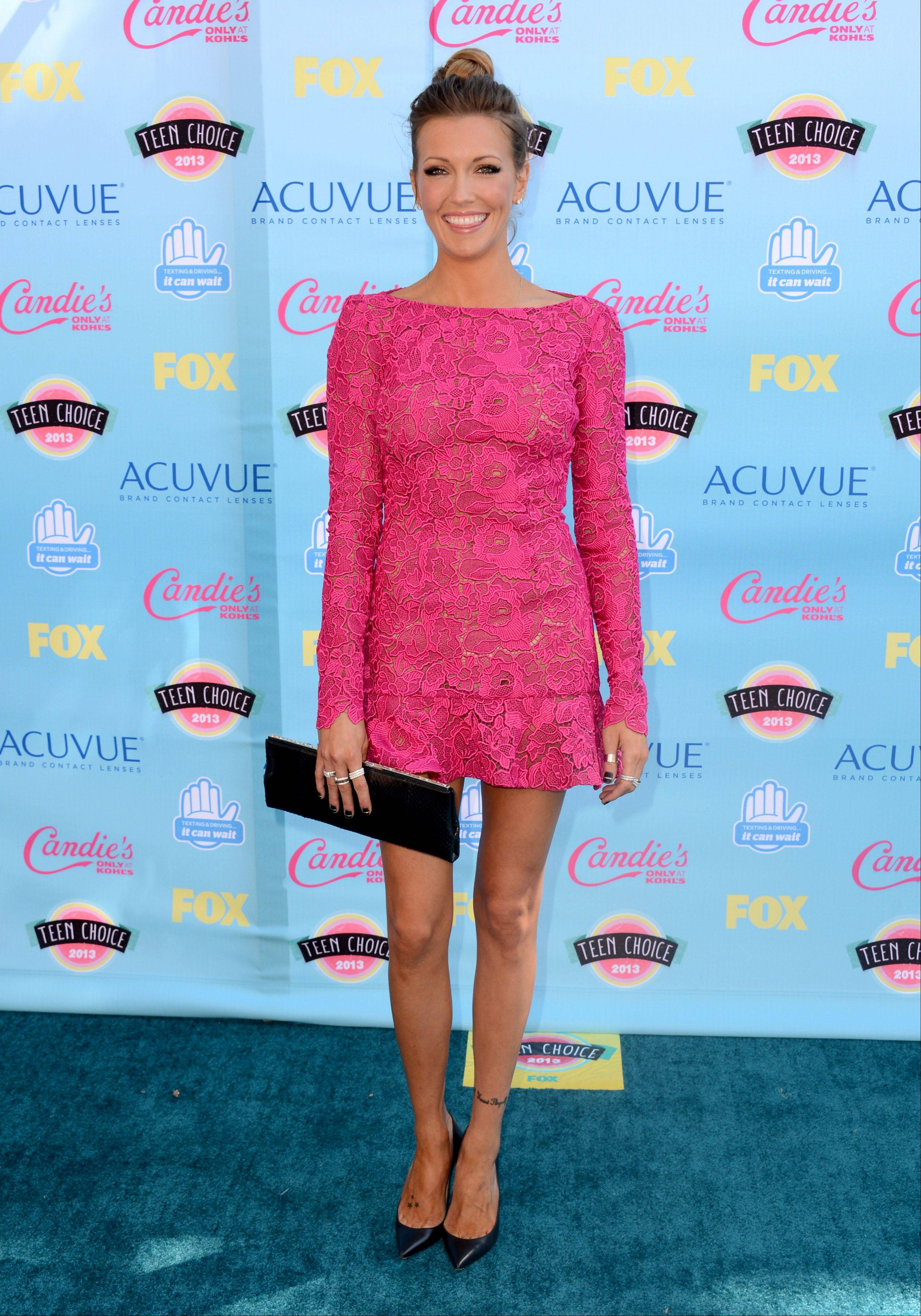"""Arrow"" star Katie Cassidy arrives at the Teen Choice Awards at the Gibson Amphitheater."