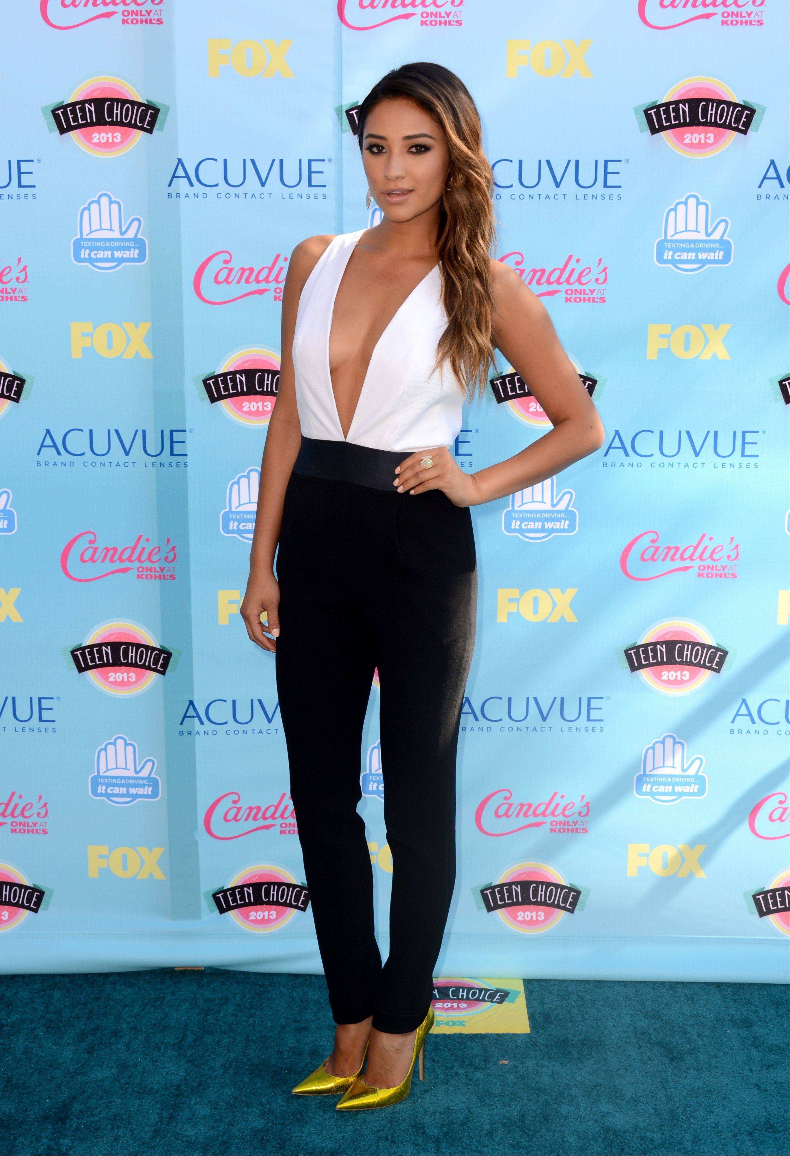 """Pretty Little Liars"" star Shay Mitchell arrives at the Teen Choice Awards at the Gibson Amphitheater on Sunday in Los Angeles."