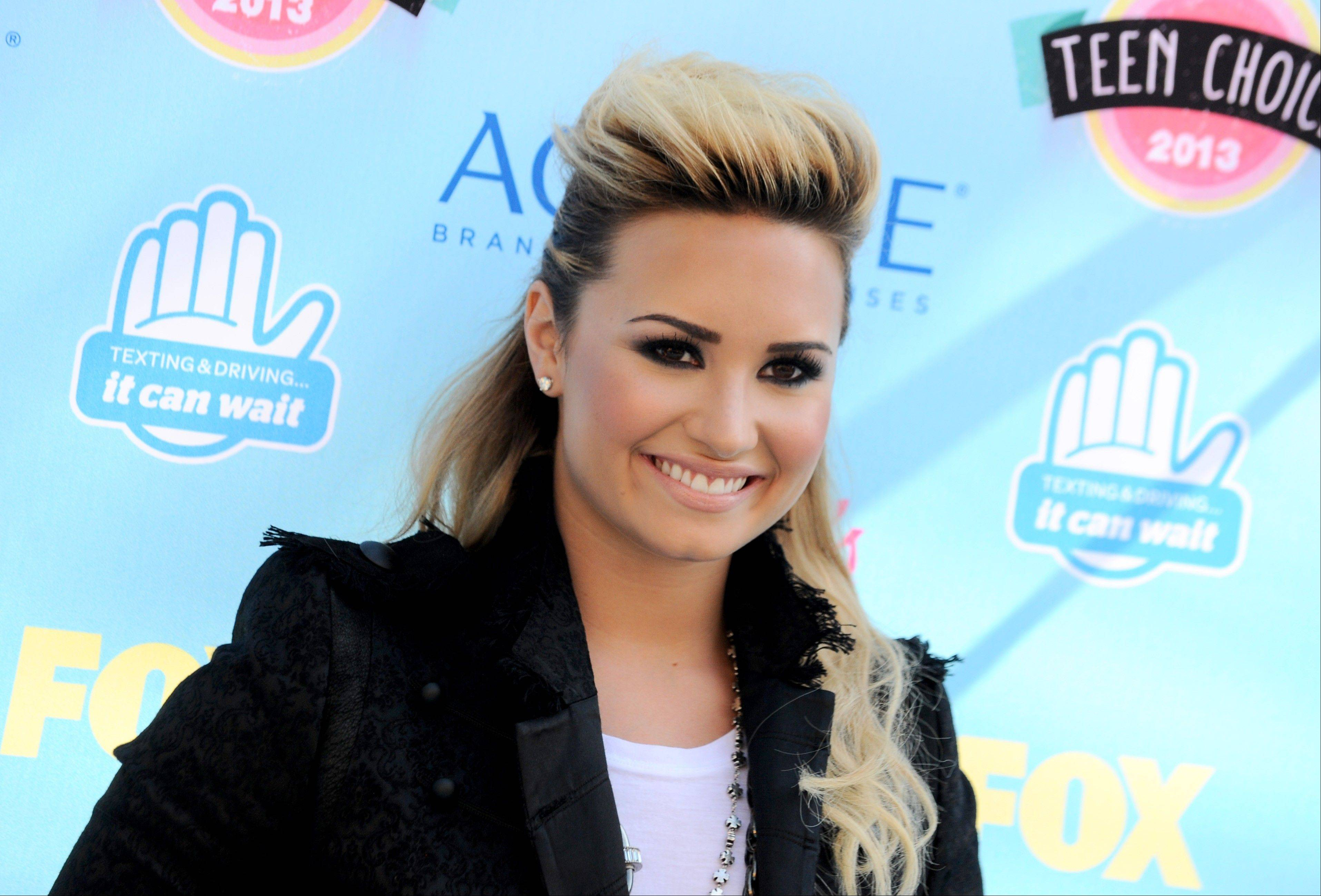"""X Factor"" judge and singer Demi Lovato arrives at the Teen Choice Awards at the Gibson Amphitheater on Sunday in Los Angeles."