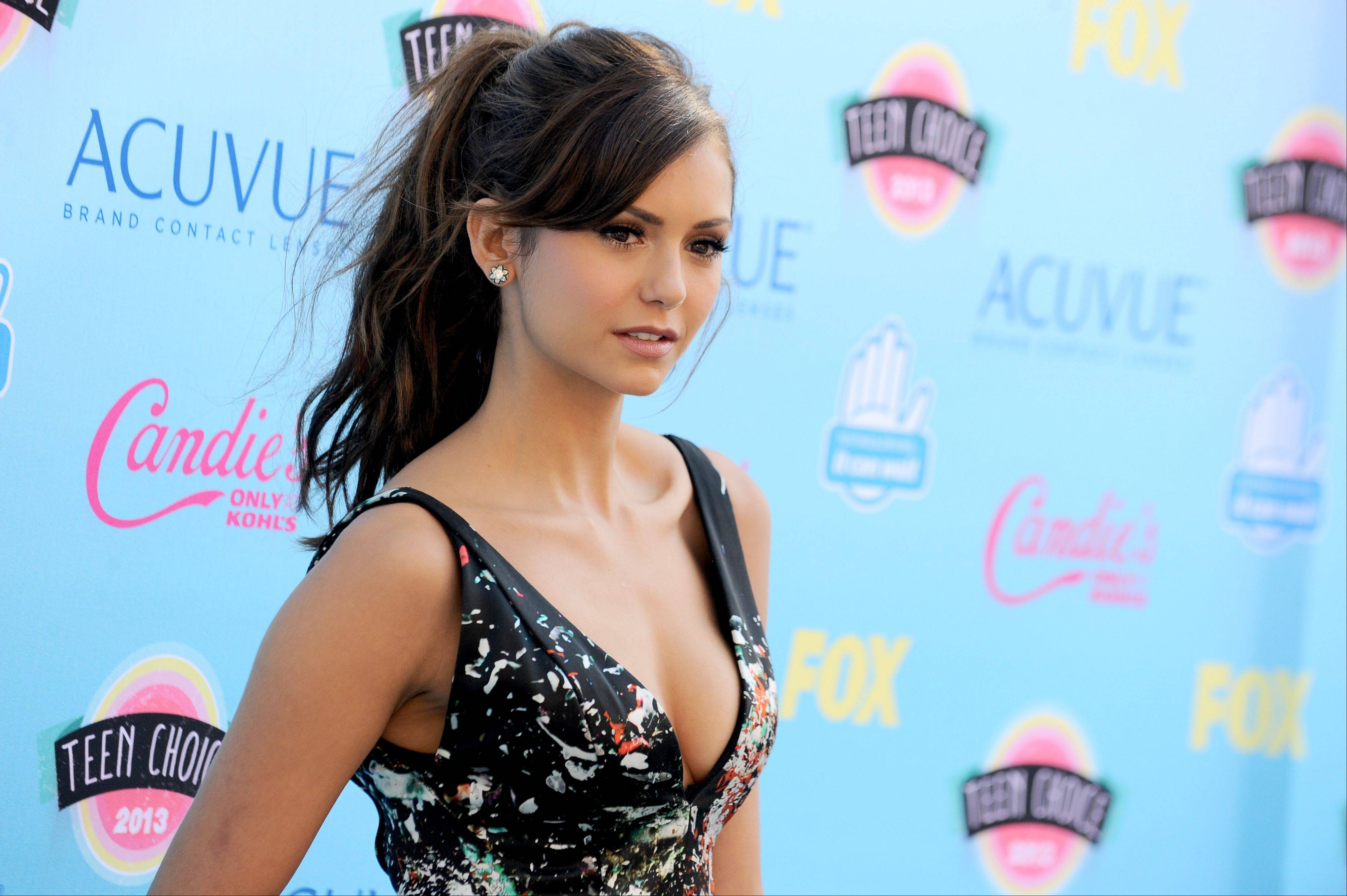 """The Vampire Diaries"" star Nina Dobrev arrives at the Teen Choice Awards at the Gibson Amphitheater on Sunday in Los Angeles."