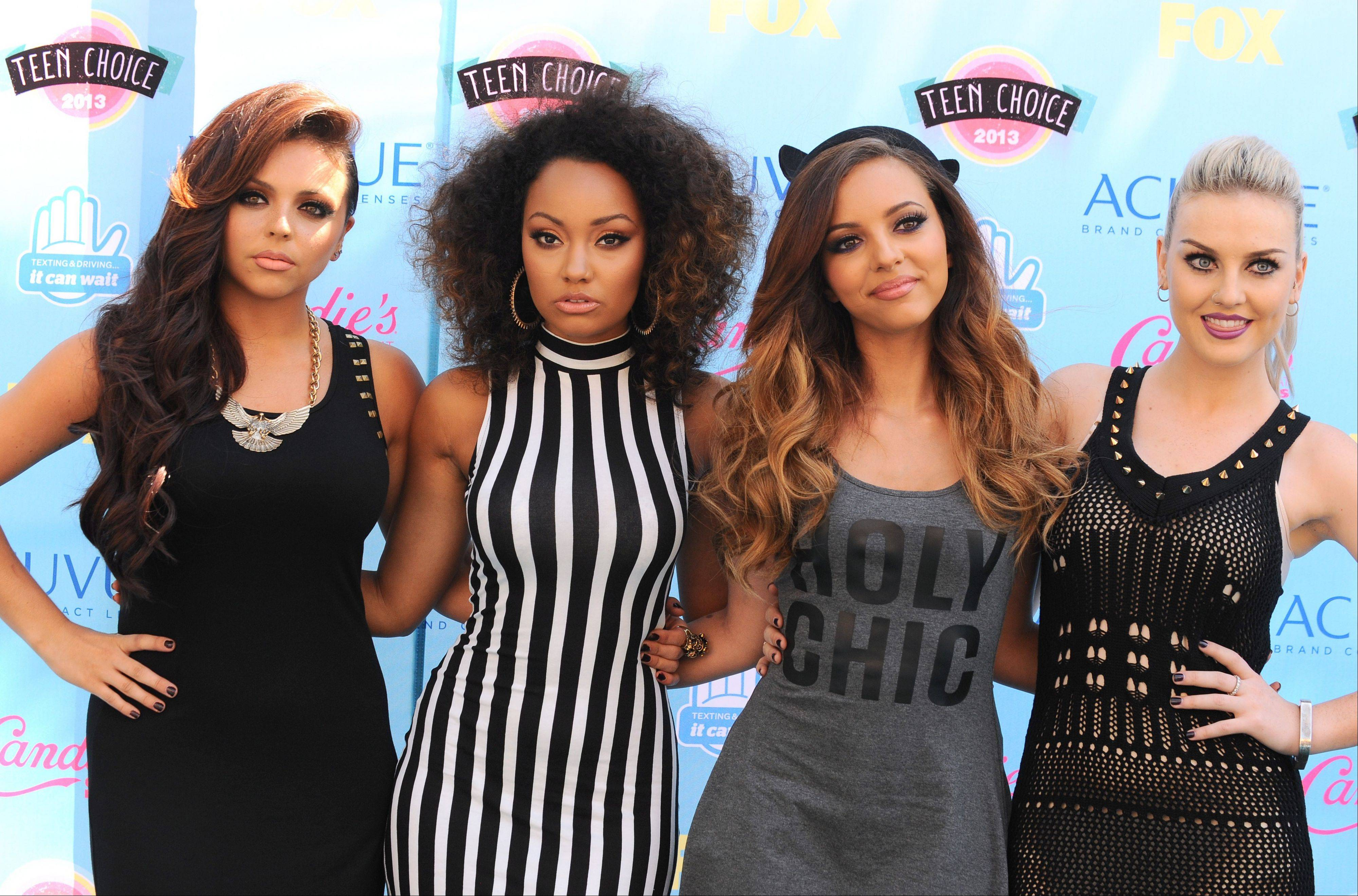 Jesy Nelson, from left, Leigh-Anne Pinnock, Jade Thirwall and Perrie Edwards of the musical group Little Mix arrive at the Teen Choice Awards at the Gibson Amphitheater on Sunday.