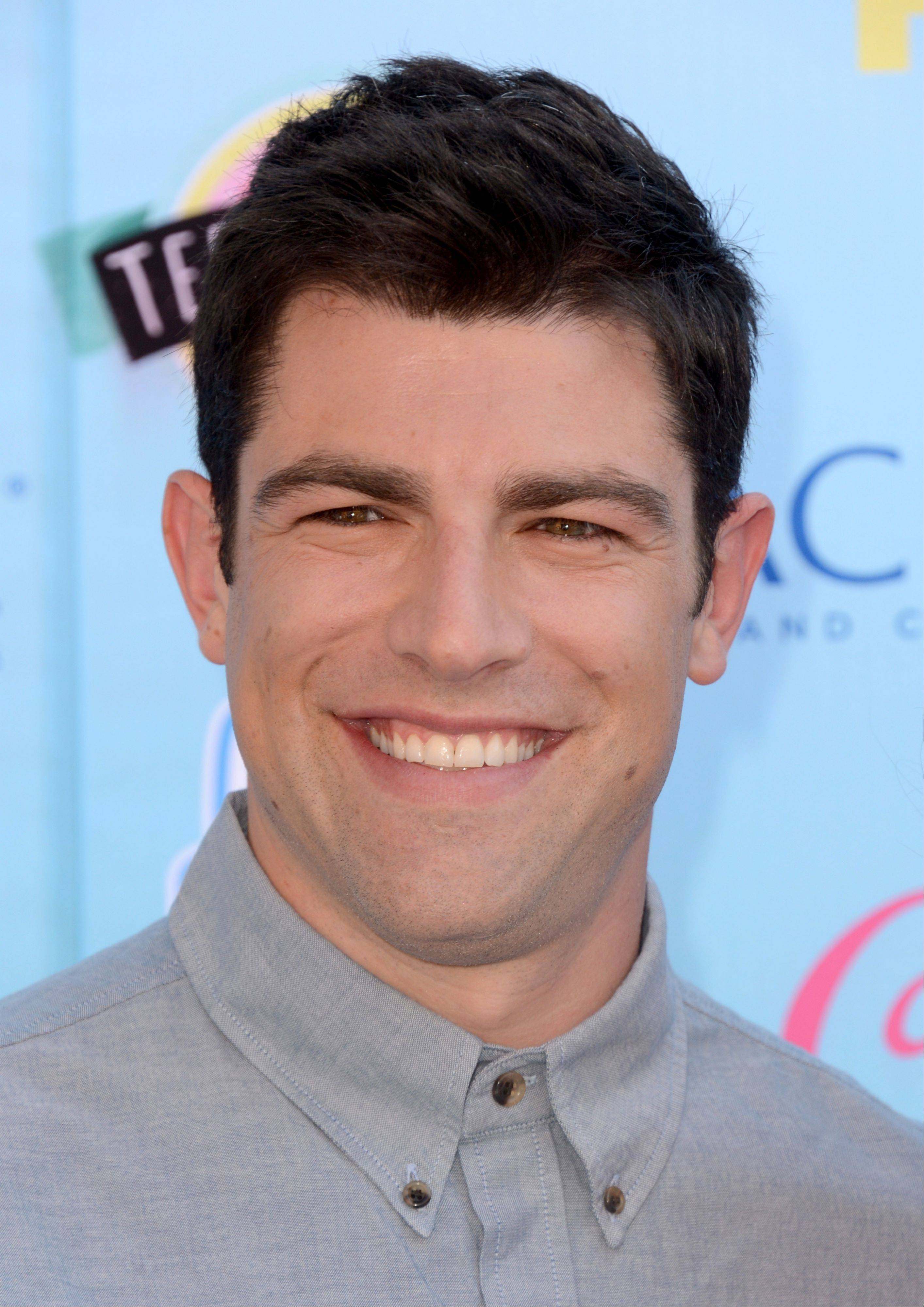 """New Girl"" star Max Greenfield arrives at the Teen Choice Awards at the Gibson Amphitheater on Sunday."