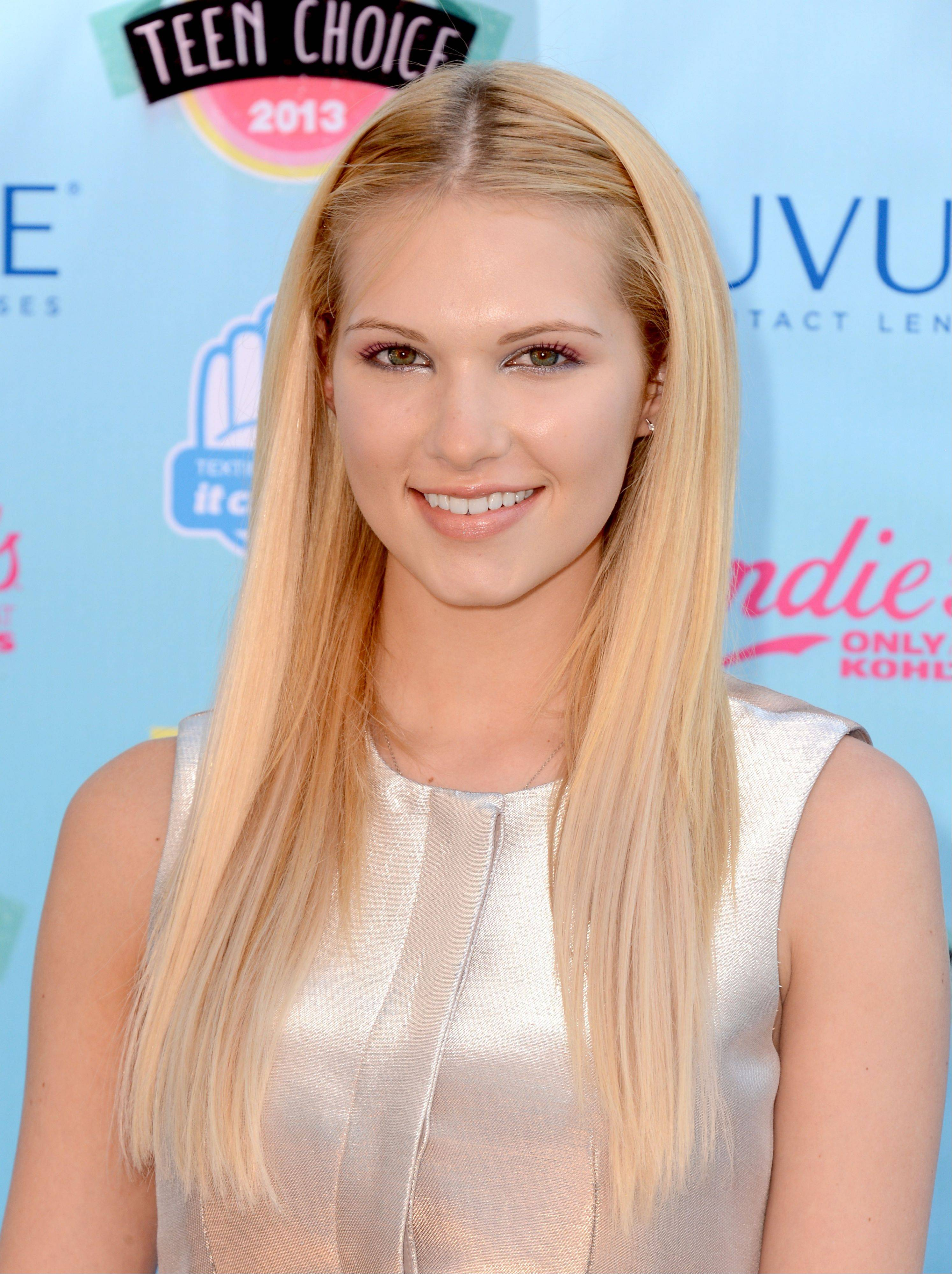 """Hart of Dixie"" star Claudia Lee arrives at the Teen Choice Awards on Sunday."