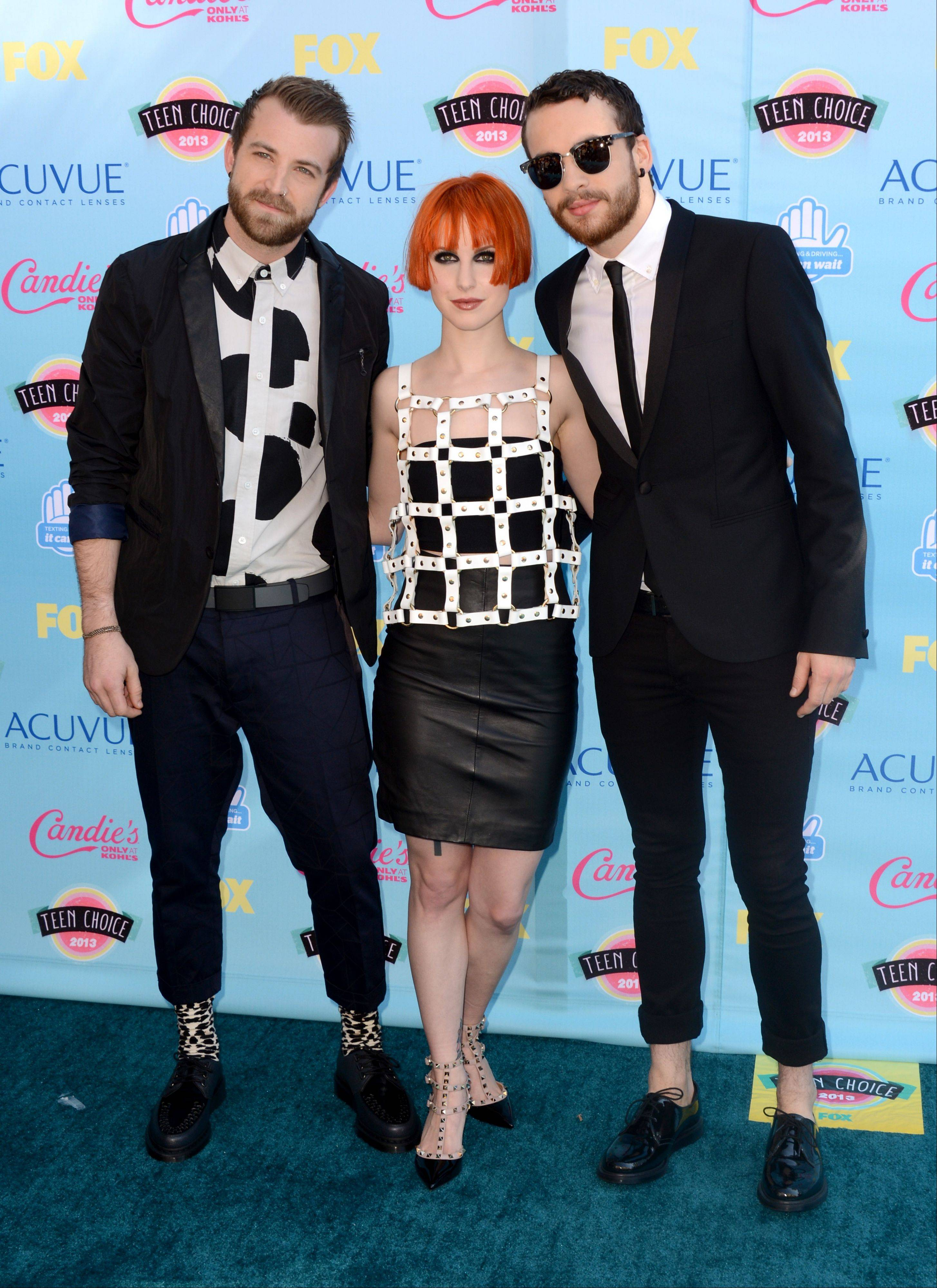 Jeremy Davis, from left, Hayley Williams and Taylor York of the musical group Paramore arrive at the Teen Choice Awards at the Gibson Amphitheater.