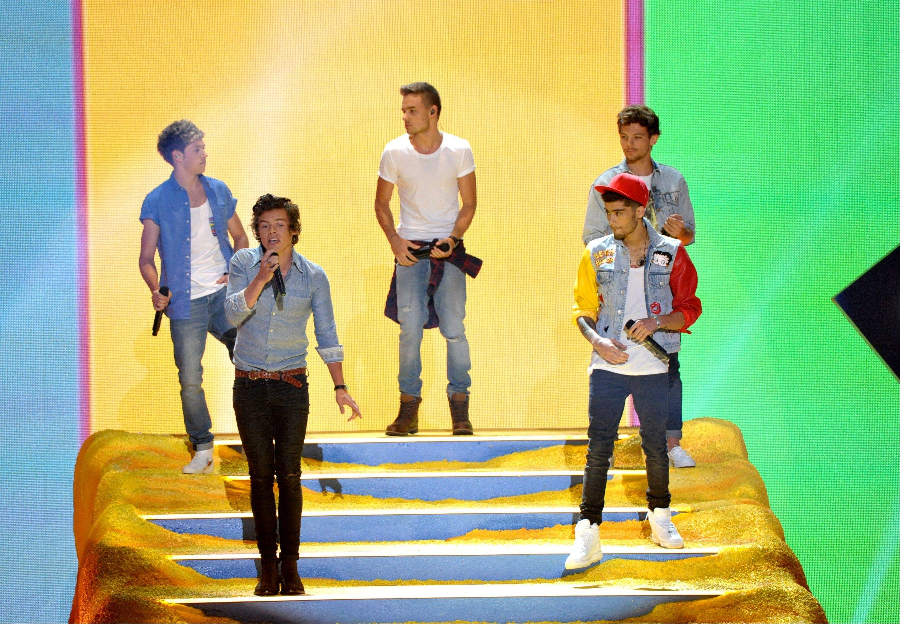 Niall Horan, from left, Harry Styles, Liam Payne, Zayn Malik and Louis Tomlinson of the musical group One Direction perform on stage at the Teen Choice Awards.