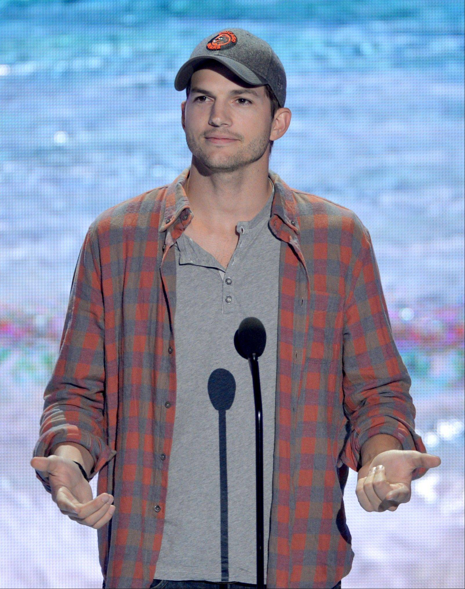 Actor Ashton Kutcher accepts the ultimate choice award at the Teen Choice Awards at the Gibson Amphitheater on Sunday.