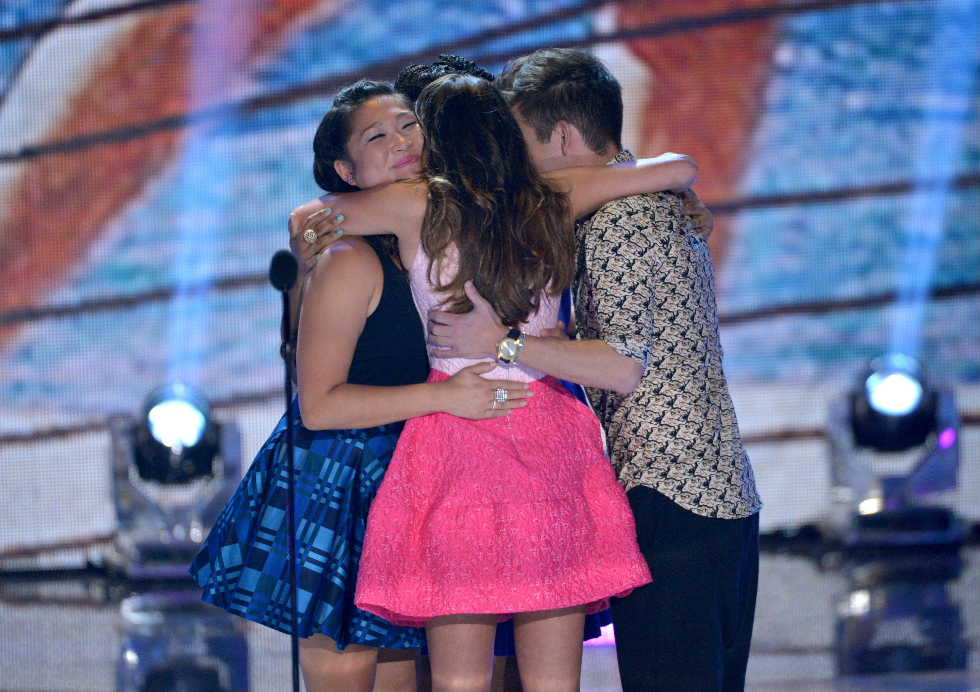 "The cast of ""Glee"", from left, Jenna Ushkowitz, Lea Michele and Kevin McHale hug on stage at the Teen Choice Awards at the Gibson Amphitheater on Sunday."