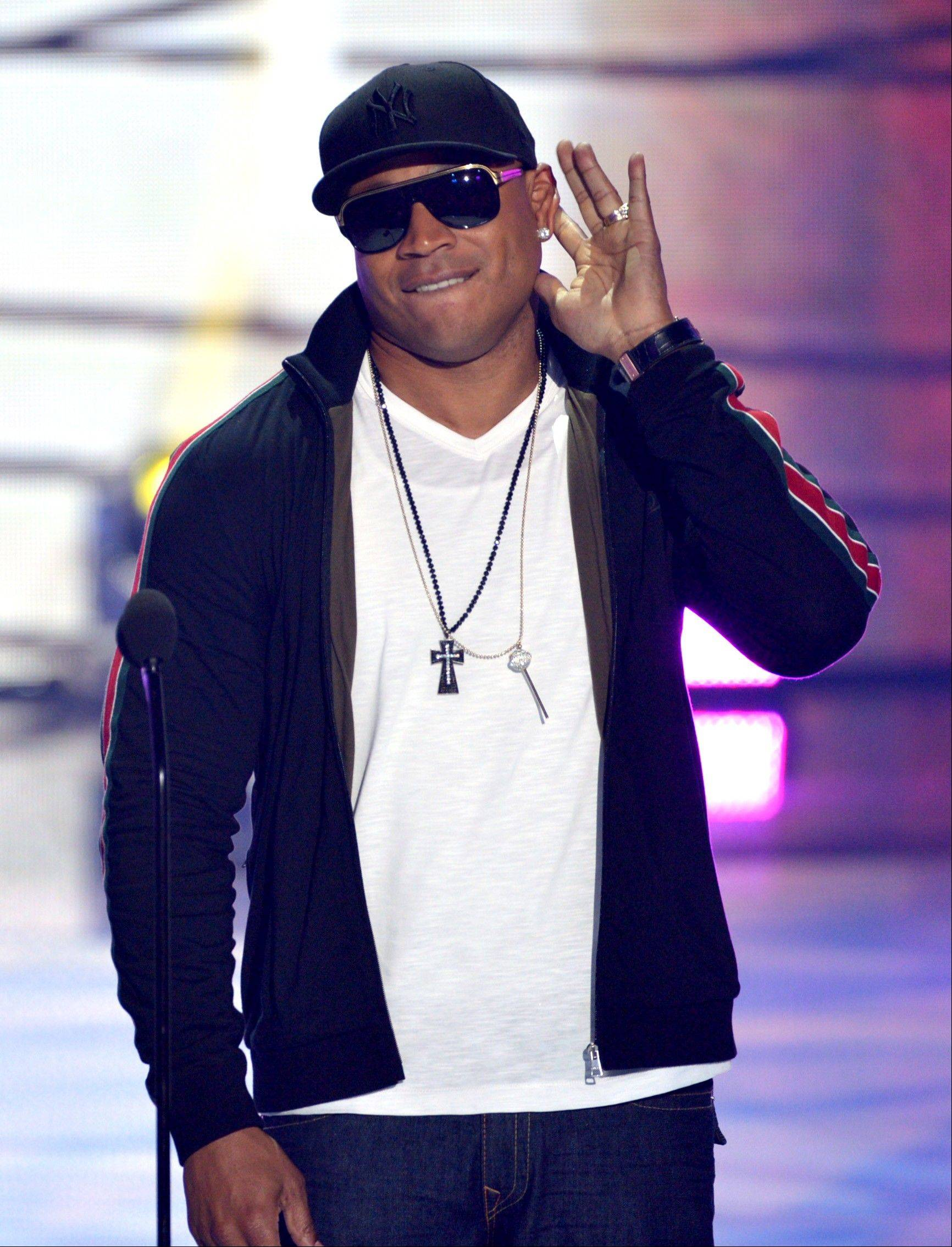 "Presente, ""NCIS: LA"" star and hip-hop artist LL Cool J speaks on stage at the Teen Choice Awards at the Gibson Amphitheater on Sunday."