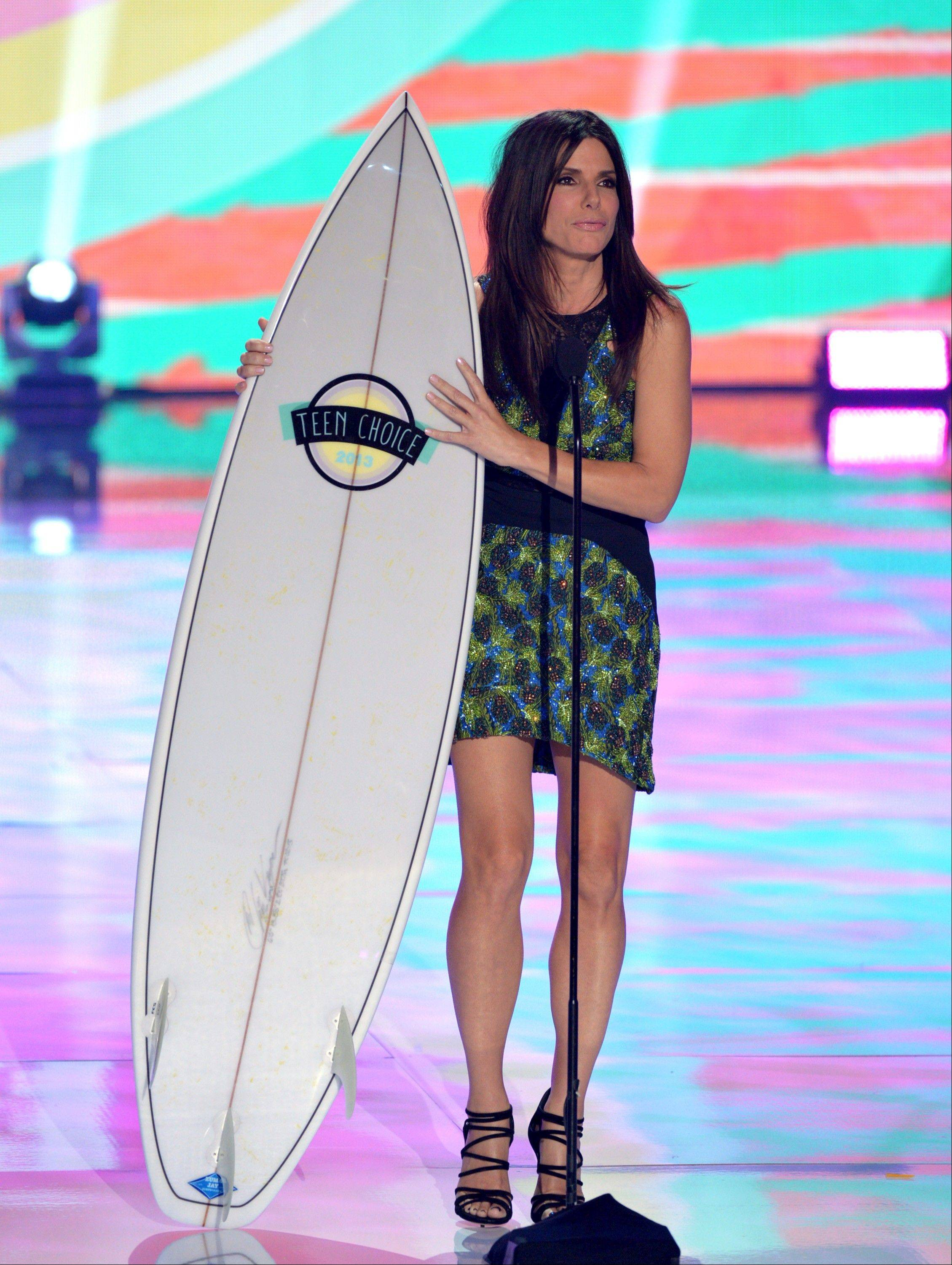 "Actress Sandra Bullock accepts the choice summer movie star: female award for ""The Heat"" at the Teen Choice Awards."