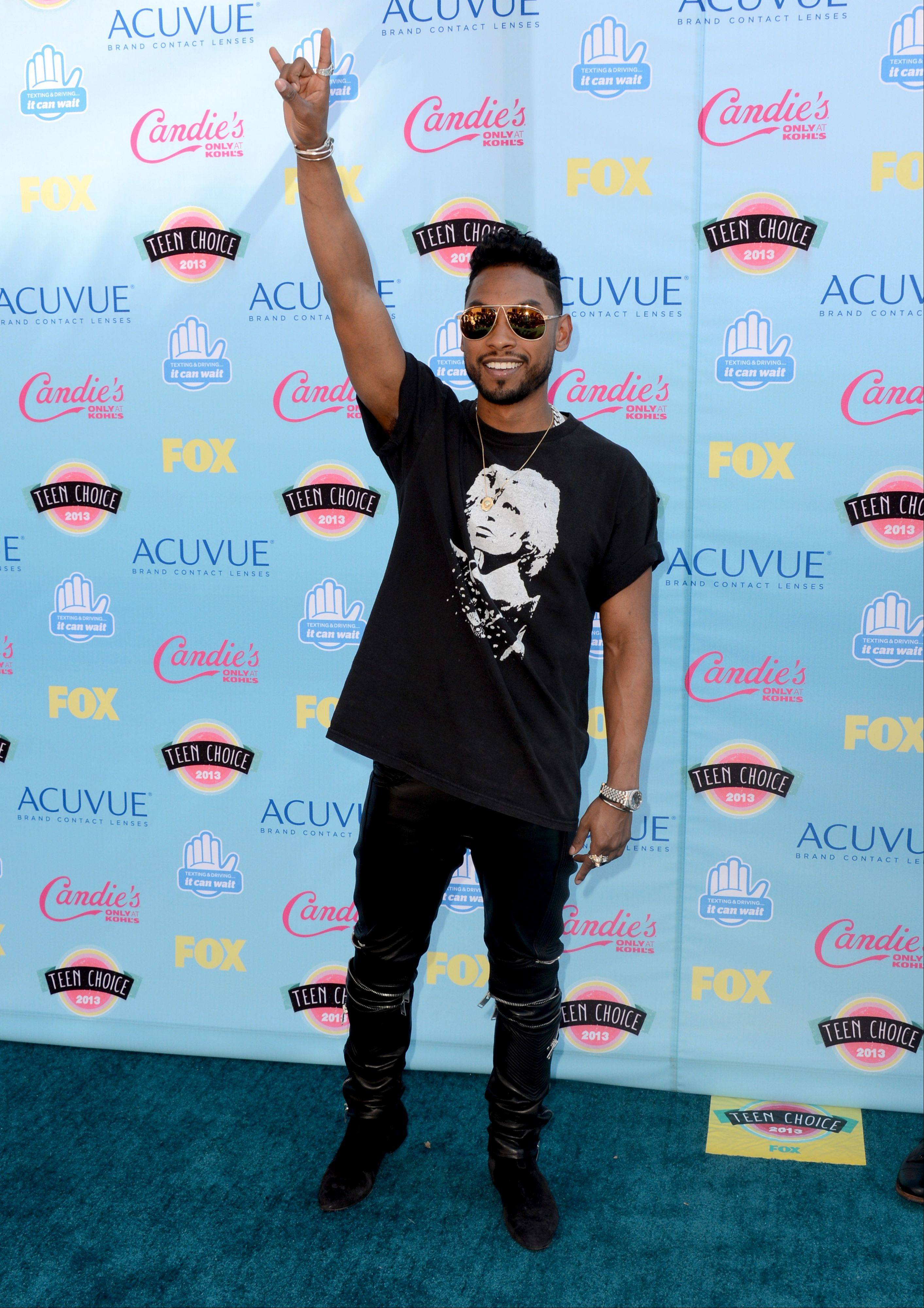 Miguel arrives at the Teen Choice Awards at the Gibson Amphitheater on Sunday.
