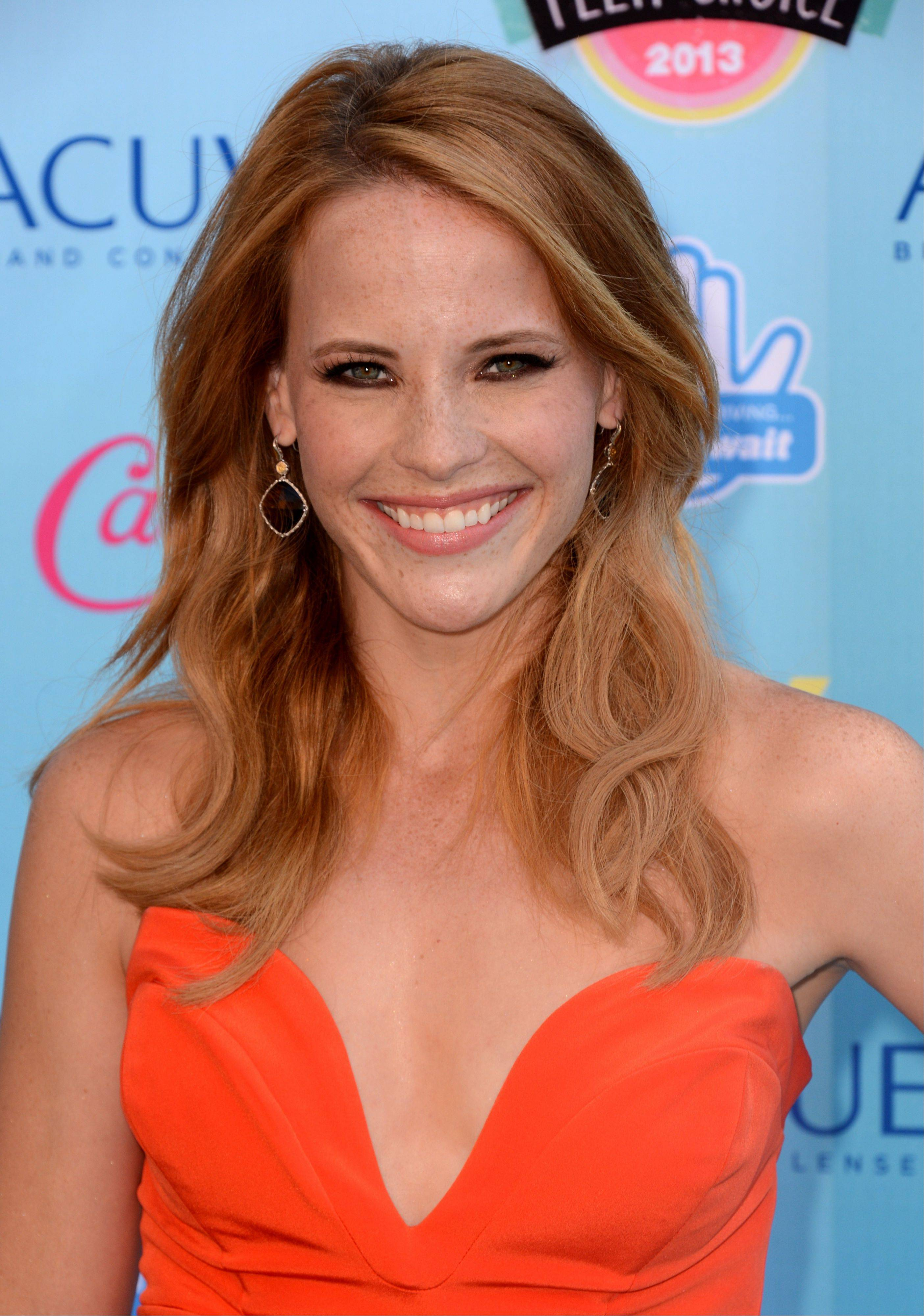 """Switched at Birth"" star Katie Leclerc arrives at the Teen Choice Awards at the Gibson Amphitheater on Sunday in Los Angeles."