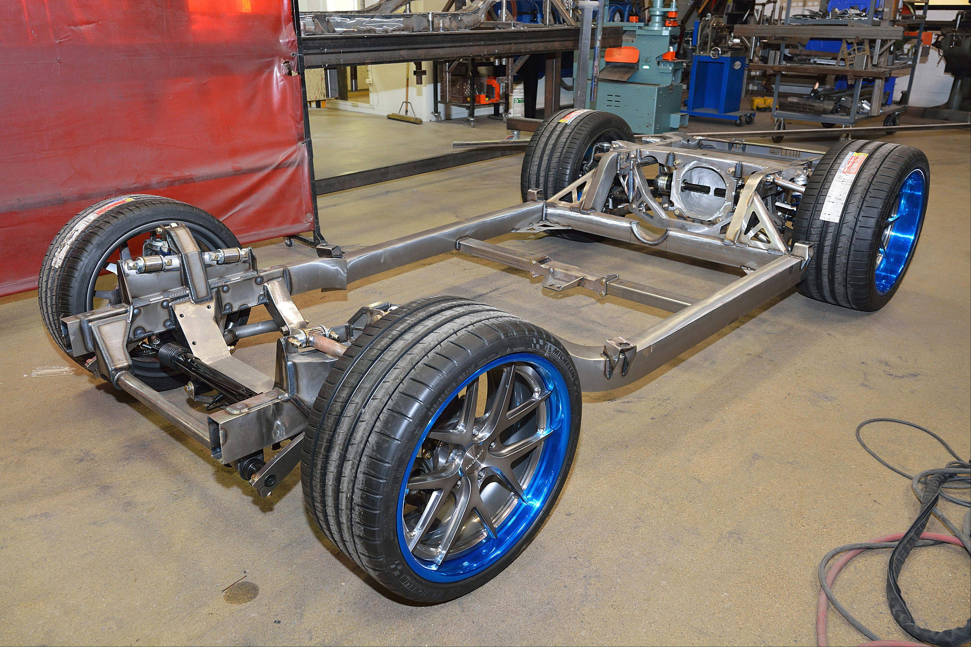 A nearly complete Roadster Shop chassis with new suspension, brakes and wheels installed.