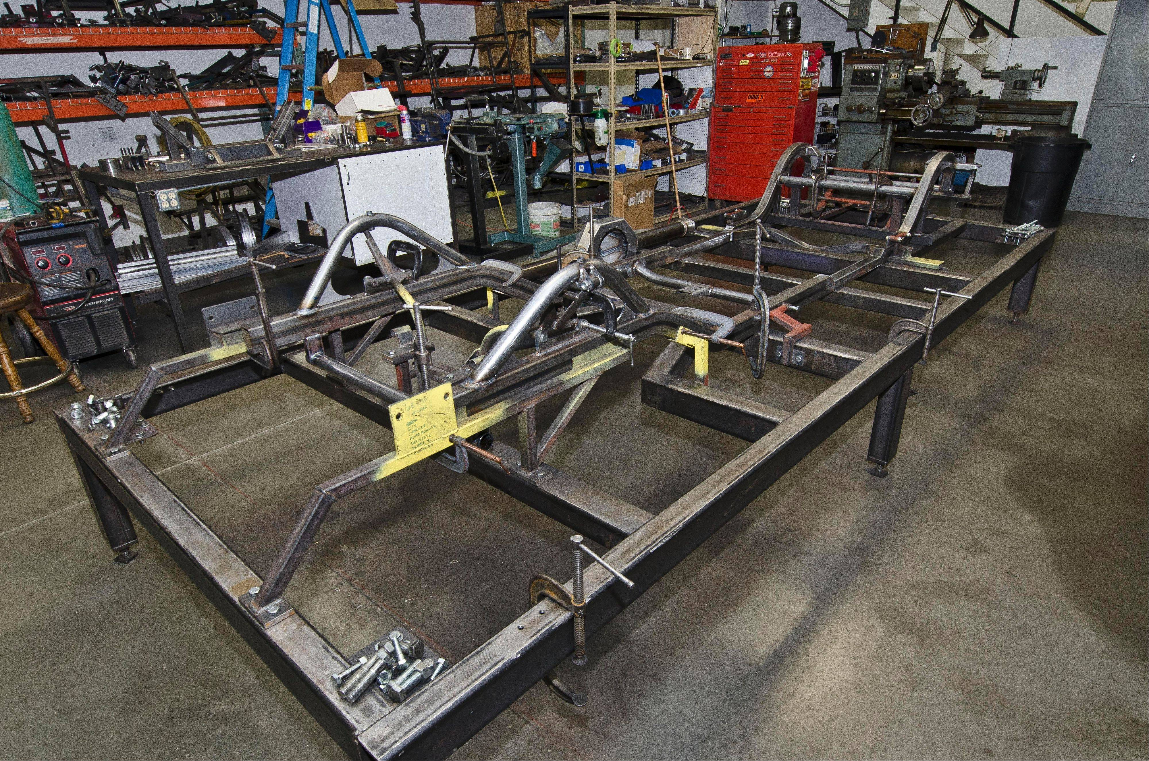 A new chassis begins to take shape on this welding frame at Schwartz Performance in Woodstock.