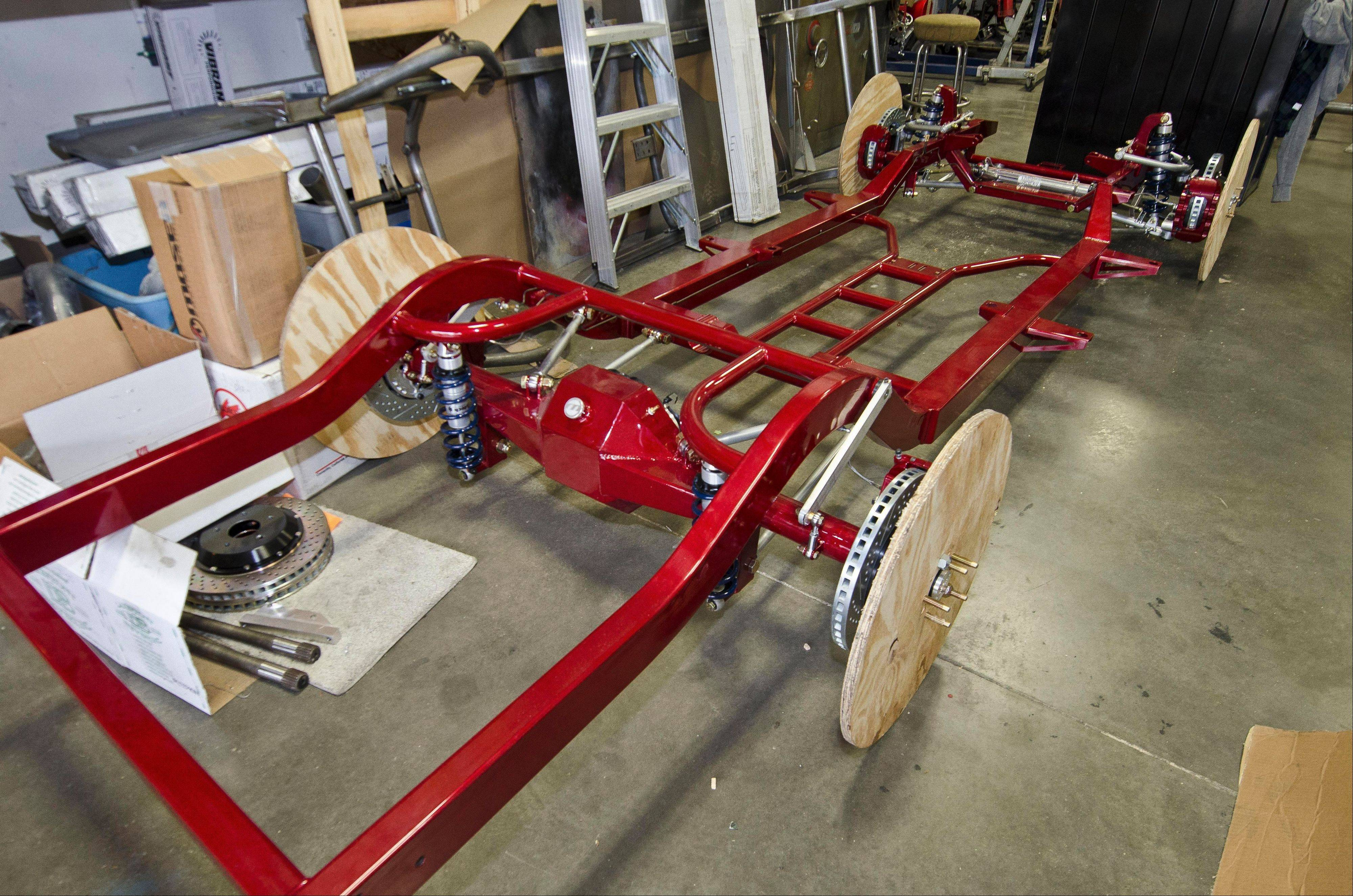 "Wooden ""wheel bucks"" are used to move new chassis' around the Schwartz Performance shop."
