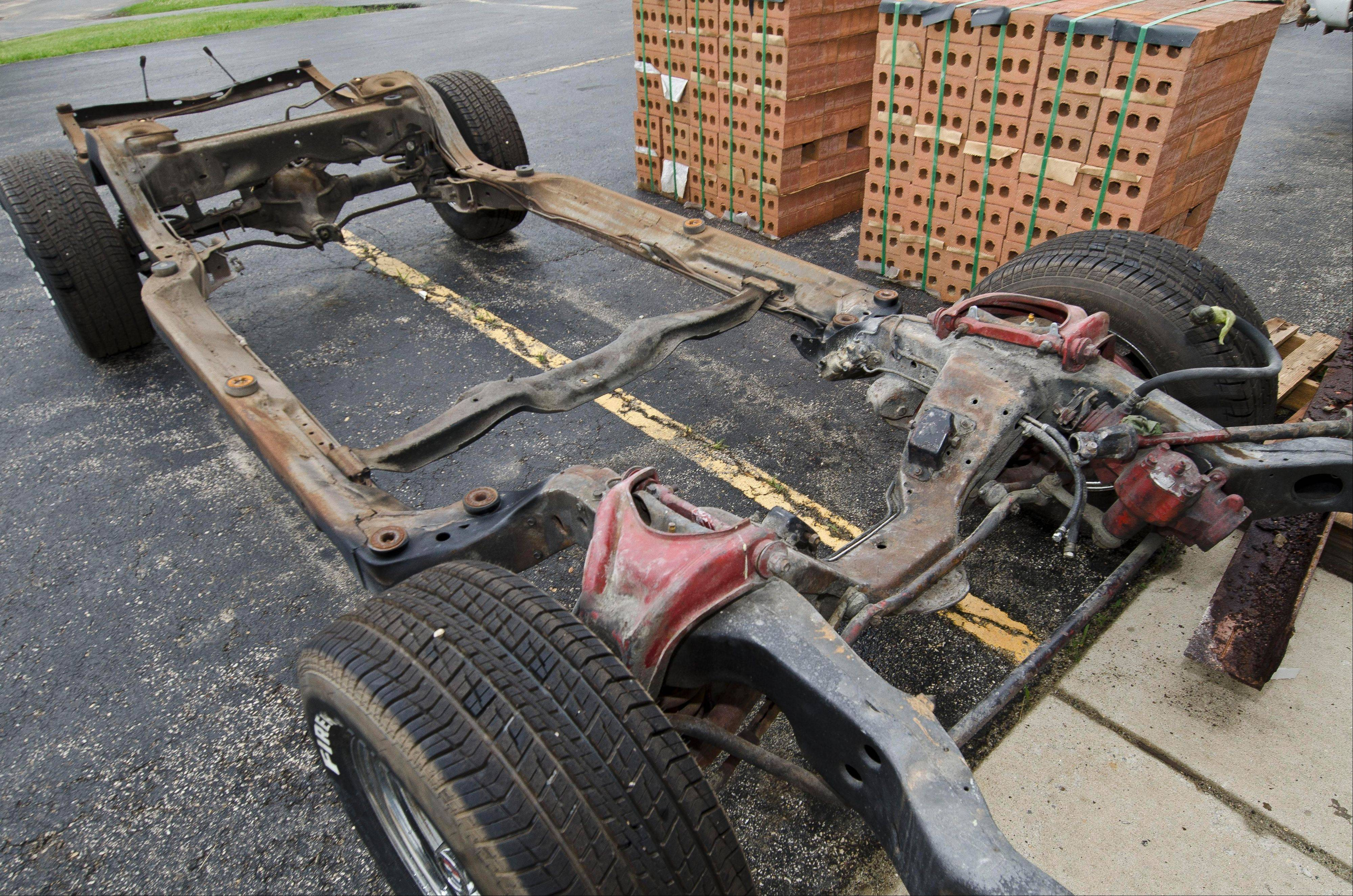 The old frame after it has been removed from a vehicle at Schwartz Performance in Woodstock.
