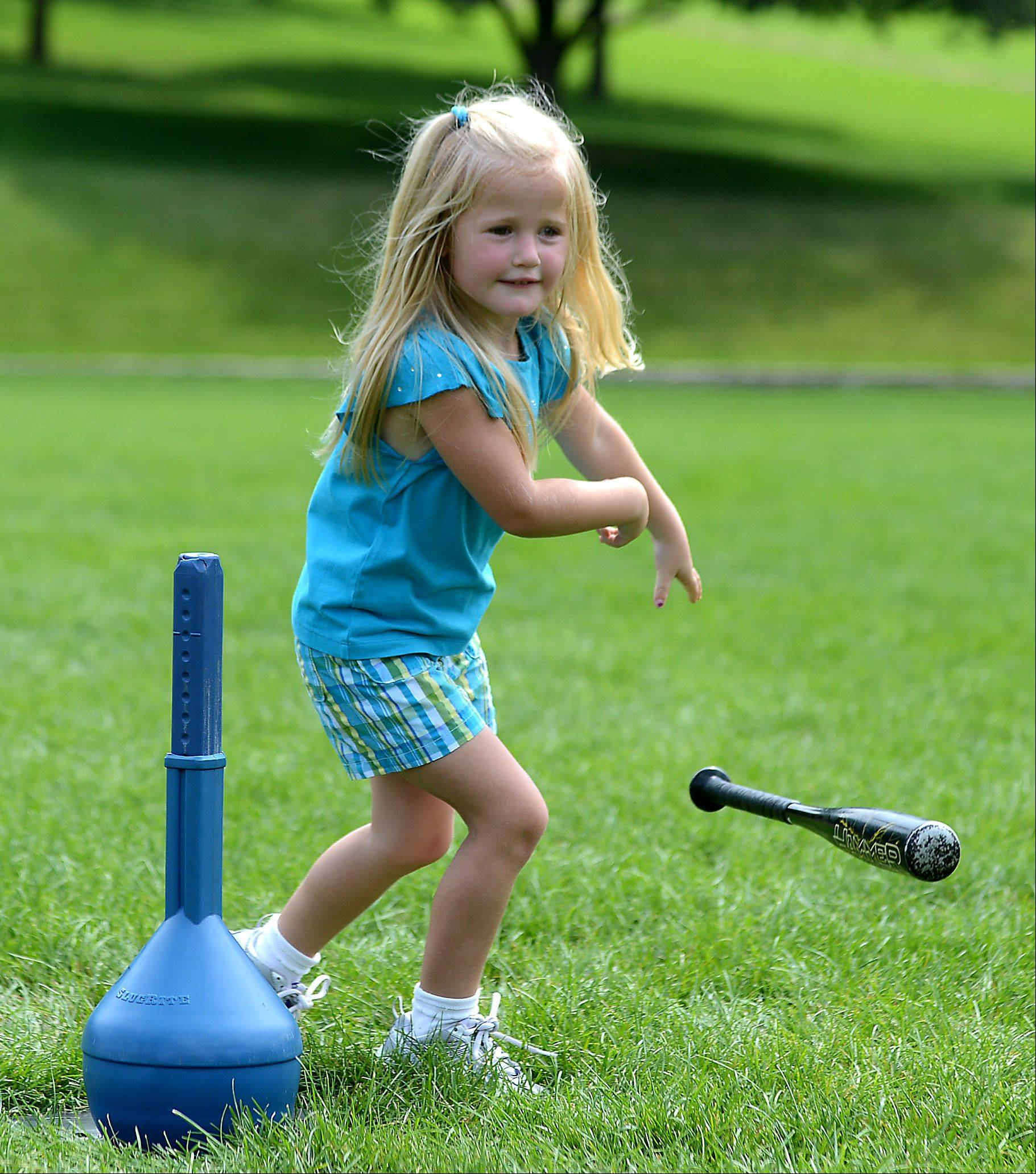 Alexa Elmer, 4, of South Elgin, drops the bat and takes off running for first base after getting a hit during an All Star Sports Camps T-Ball camp at Pottawatomie Park in St. Charles Wednesday.