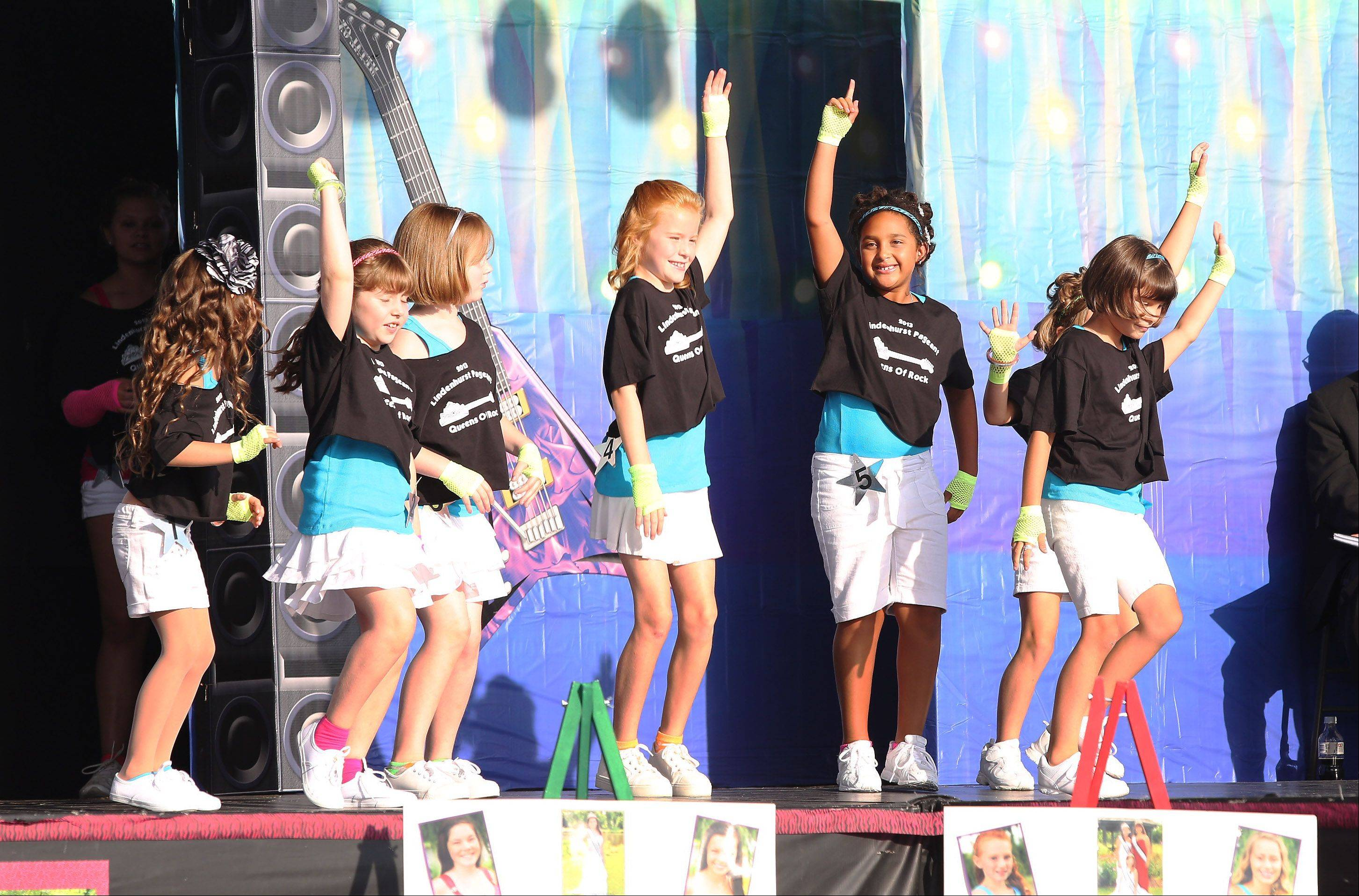 2013 Little Miss Lindenhurst contestants dance together to open the pageant during the first day of Lindenfest Thursday on the Lindenhurst Village Hall grounds.